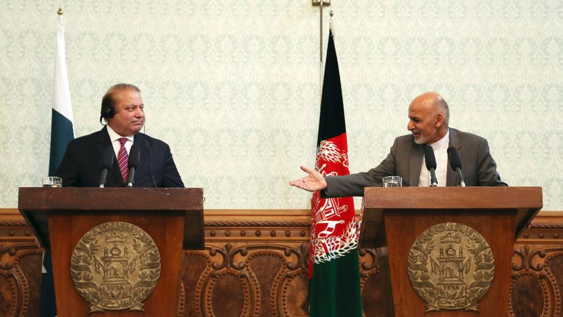 FILE - In a May 12, 2015 file photo, Afghan President Ashraf Ghani, right, speaks as Pakistani Prime Minister Nawaz Sharif listens during a joint press conference at the presidential palace in Kabul, Afghanistan. Pakistan said Wednesday, July 8, 2015, that the first official face-to-face discussions between Afghan government officials and the Taliban have made progress, with the two sides agreeing at a meeting near Islamabad to work on confidence-building measures and hold more such talks after the Muslim holy month of Ramadan. (AP Photo/Rahmat Gul, File)
