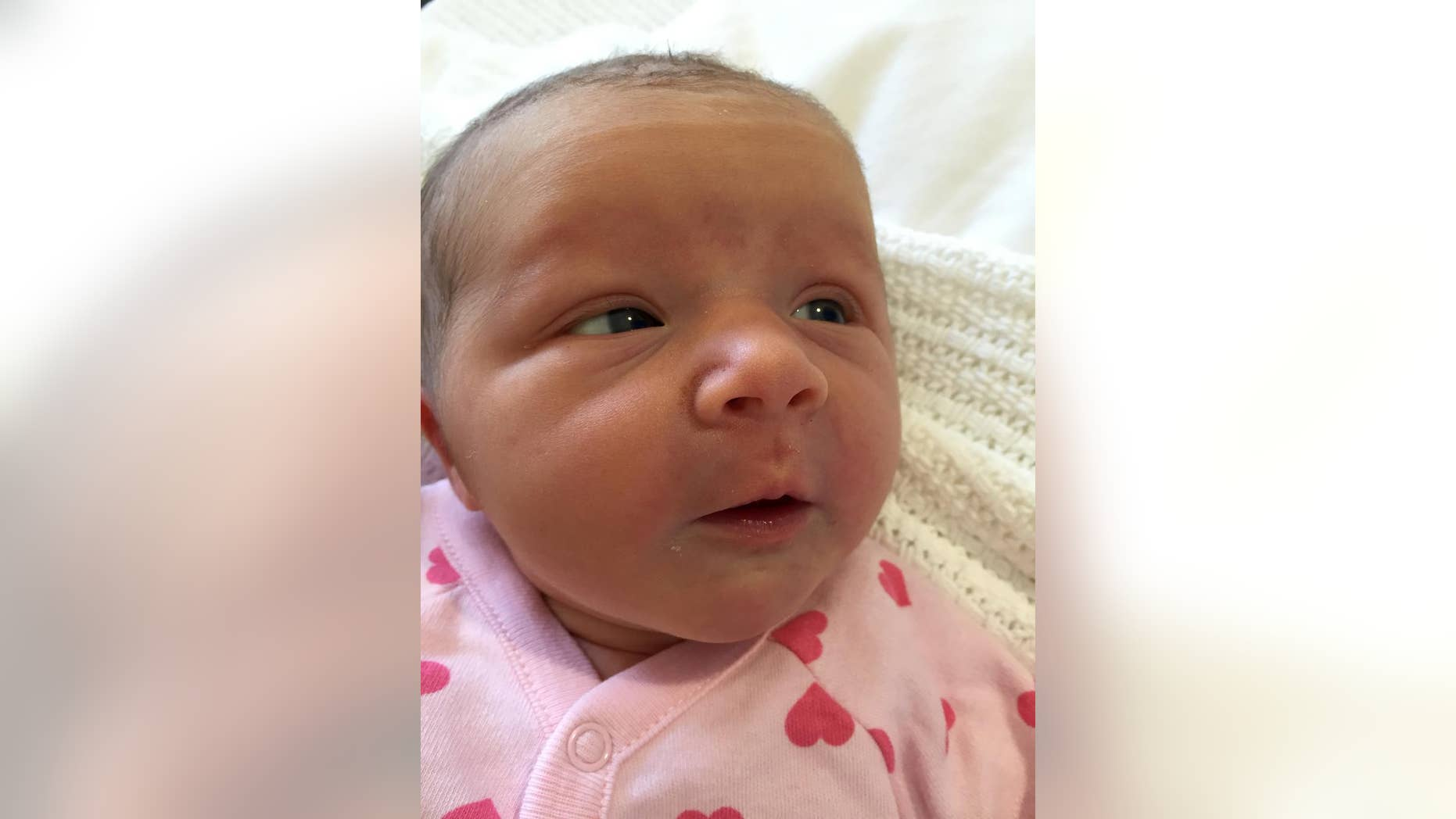 In this undated family handout photo distributed by the Australian Department of Foreign Affairs and Trade, baby Violet May Maslin is photographed shortly after her birth, Tuesday, May 10, 2016, in Perth, Australia. An Australian couple whose three children were killed in the downing of Malaysia Airlines Flight 17 two years ago has welcomed baby Violet. (Maslin Family/Australian Department of Foreign Affairs and Trade via AP) MANDATORY CREDIT