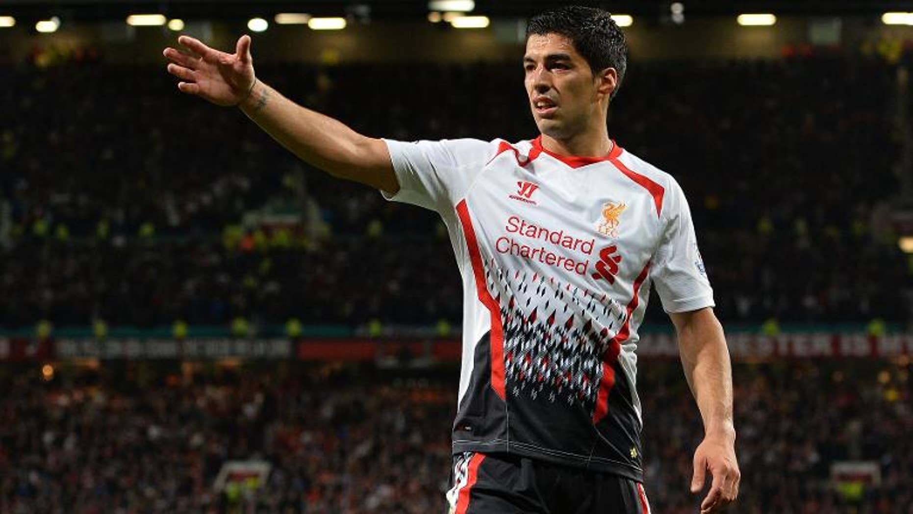 Liverpool's Uruguayan forward Luis Suarez reacts during the League Cup football match between Manchester United and Liverpool at Old Trafford in Manchester on September 25, 2013. Manchester United won 1-0.