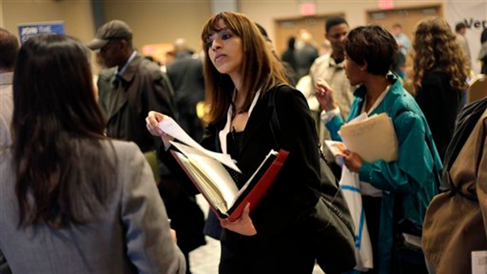 April 18, 2011: A woman at a job fair in New York talks to an employer.  (AP Photo/Seth Wenig, File)