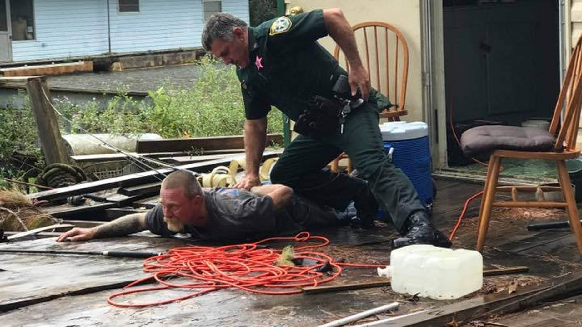 Kevin Wyatt, wanted on five warrants including sex trafficking, was captured by police after being discovered hiding on a houseboat.