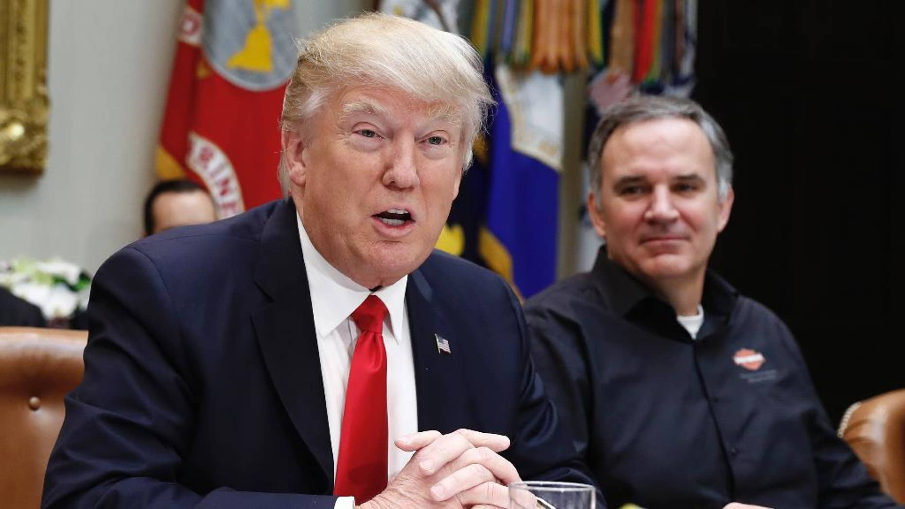 President Donald Trump, joined by Harley Davidson President and CEO Matt Levatich, talks to media before a lunch meeting with Harley Davidson executives and union representatives in the Roosevelt Room of the White House in Washington, Thursday, Feb. 2, 2017. (AP Photo/Carolyn Kaster)