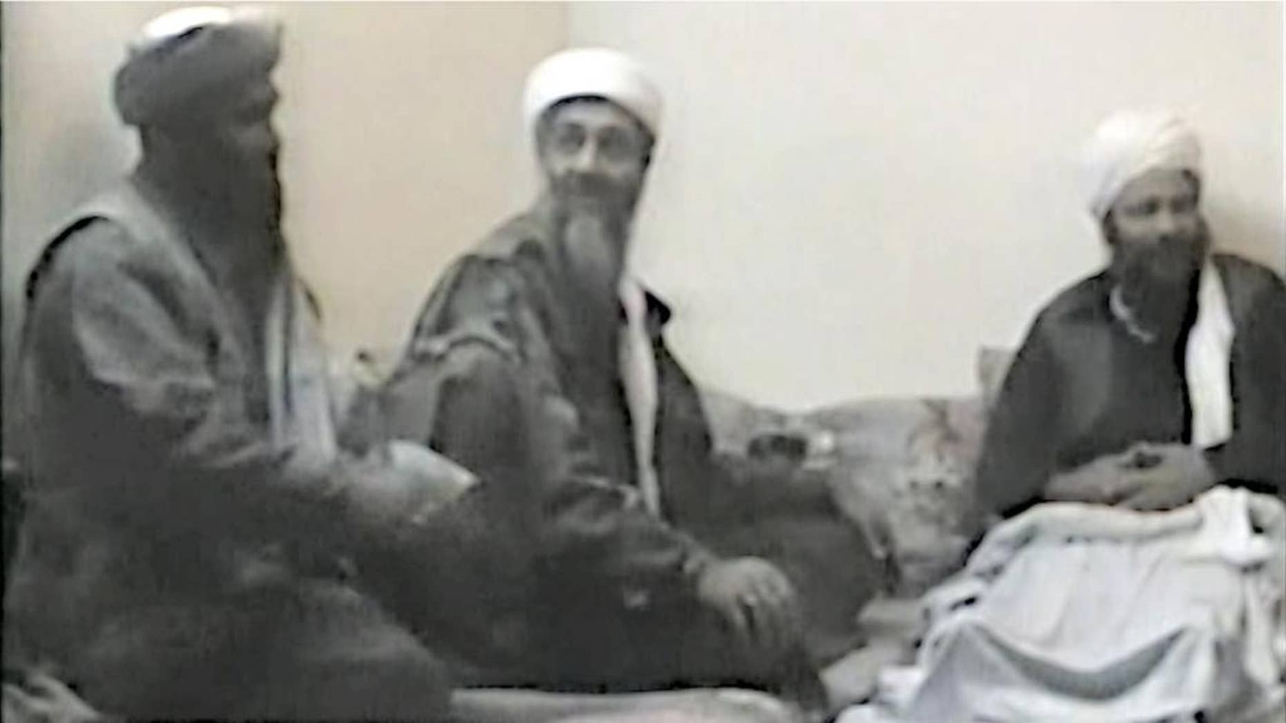 In this undated photo provided by the United States Attorney's Office for the Southern District of New York, defendant Suliman Abu Ghayth, left, joins al-Qaida founder Osama Bin Laden, center, and an unidentified man somewhere in Afghanistan. Abu Ghayth, Osama Bin Laden's son-in-law, is being tried in New York for his role as a recruiter and motivational speaker for the terror group. (AP Photo/US Attorney's Office for the Southern District of New York)