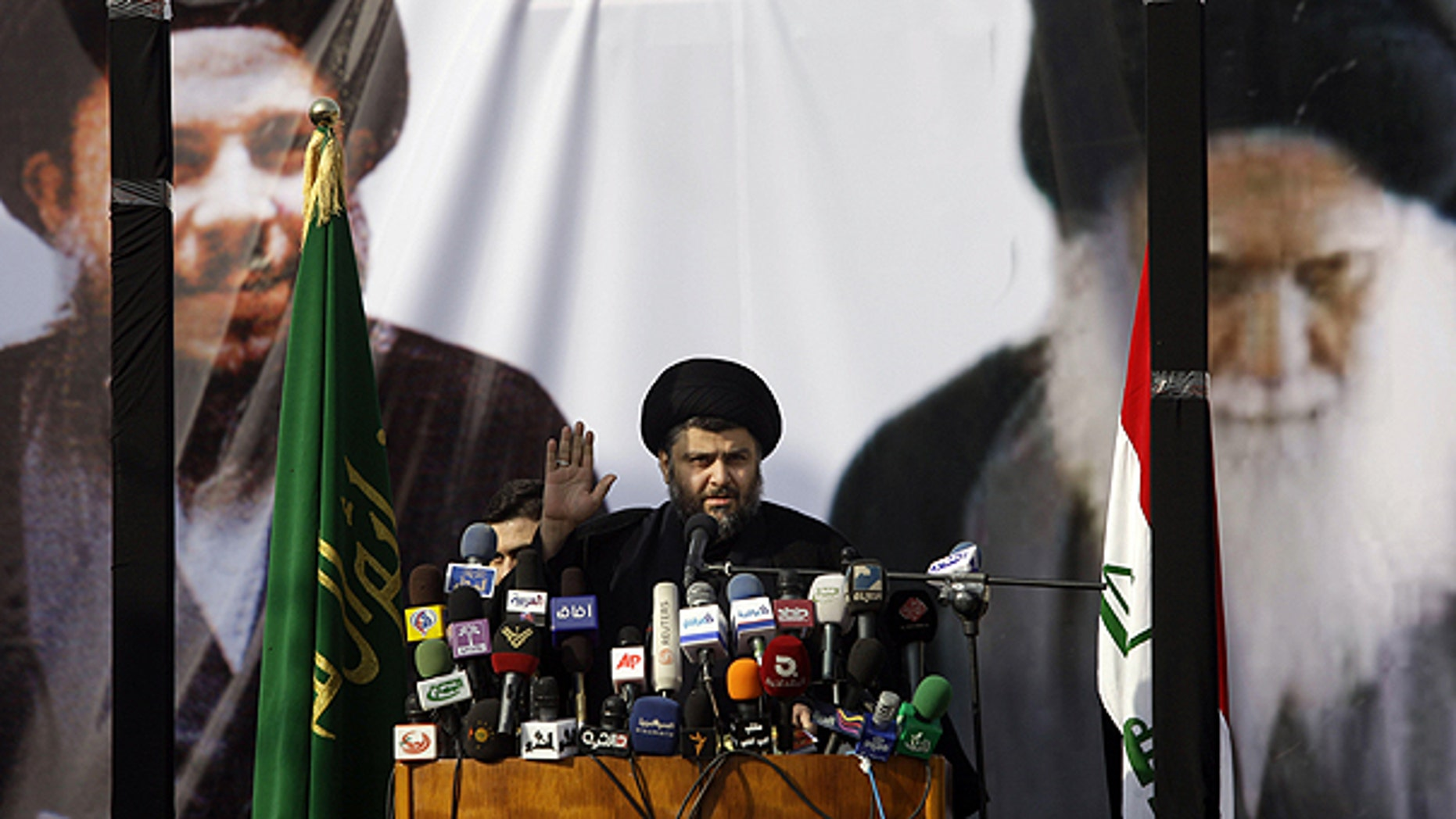 Jan. 8: Shiite cleric Muqtada al-Sadr gestures during his first public appearance since returning from nearly four years of self-imposed exile in Najaf, south of Baghdad, Iraq.