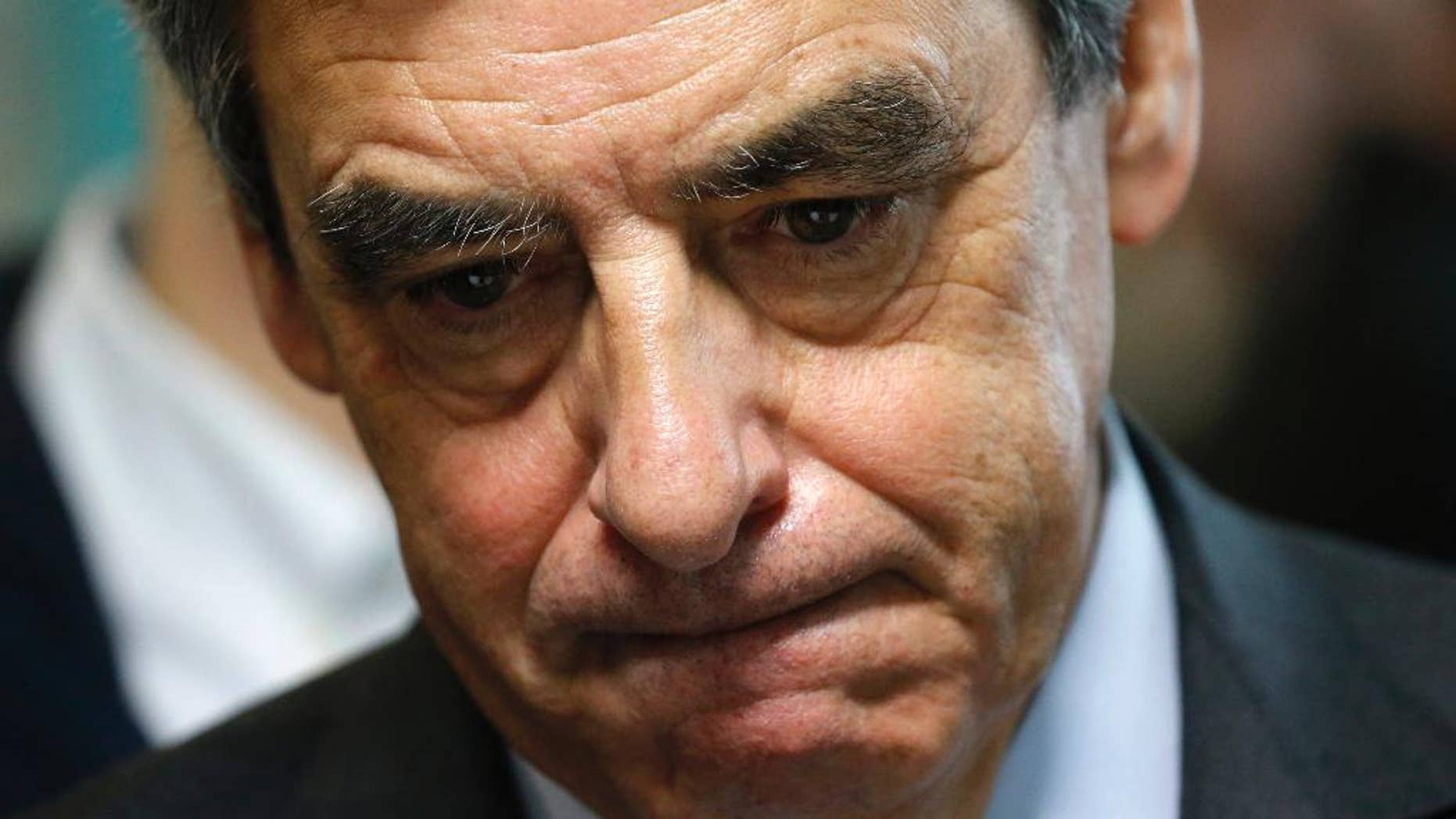 French conservative presidential candidate Francois Fillon reacts as he visits a social center as he campaigns in Tourcoing, northern France, Friday Feb. 17, 2017. French financial prosecutors decided Thursday to continue their investigation of embezzlement allegations against conservative presidential candidate Francois Fillon, saying they have too much evidence to drop the case. (Pascal Rossignol, Pool via AP)