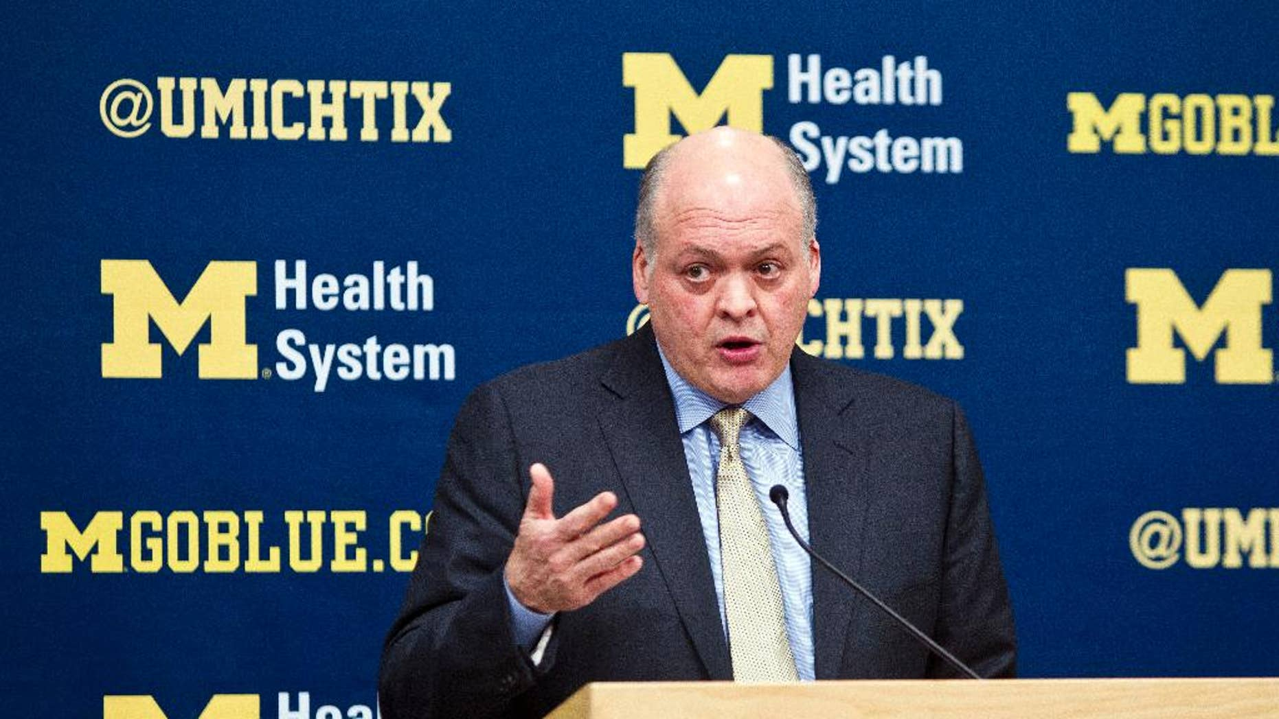 Michigan interim athletic director Jim Hackett announces the immediate dismissal of head coach Brady Hoke during a press conference in Ann Arbor, Mich., Tuesday, Dec. 2, 2014. (AP Photo/Tony Ding)