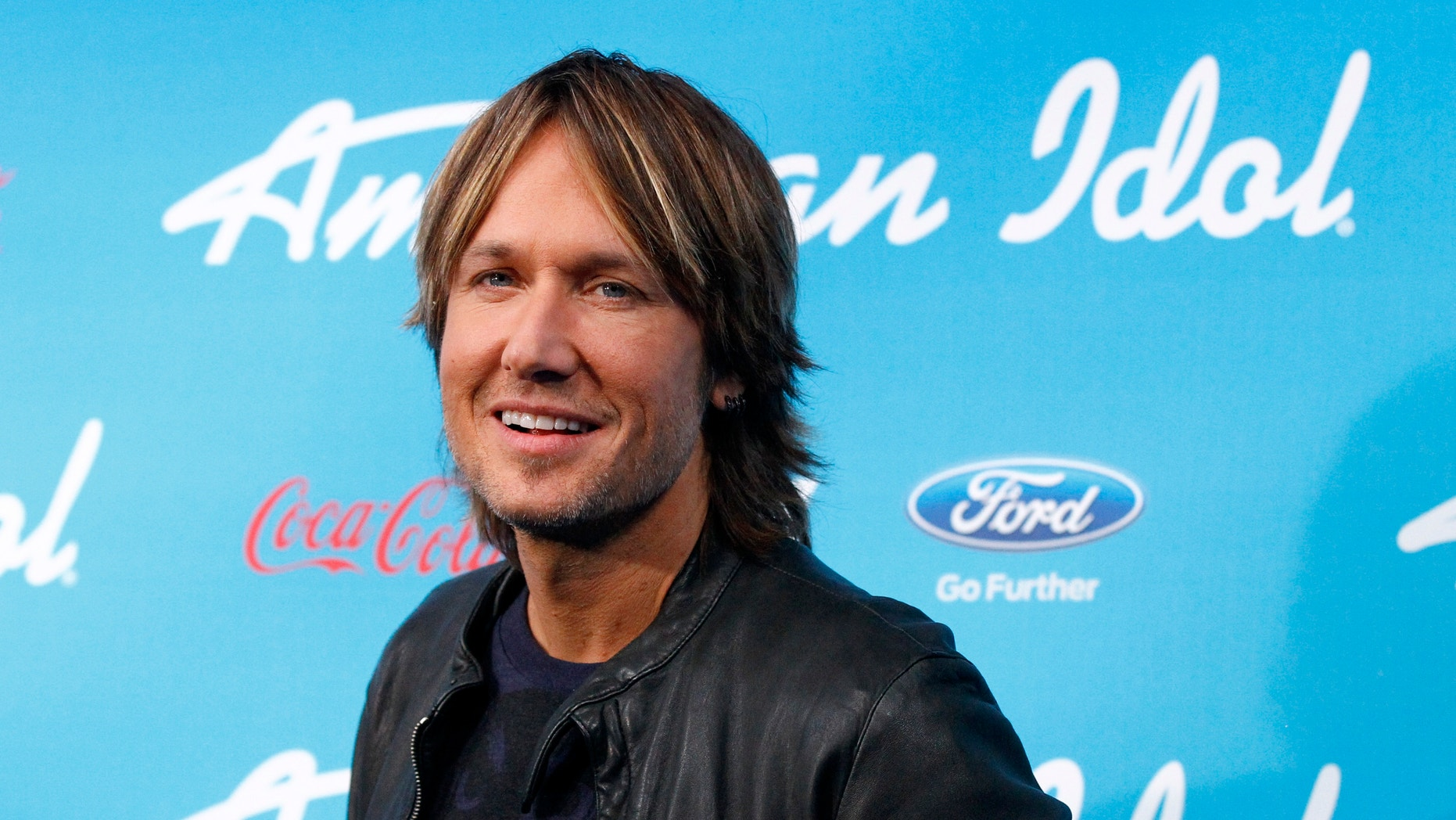 """Country singer and judge Keith Urban poses at the party for the finalists of the television show """"American Idol"""" in Los Angeles, California March 7, 2013."""
