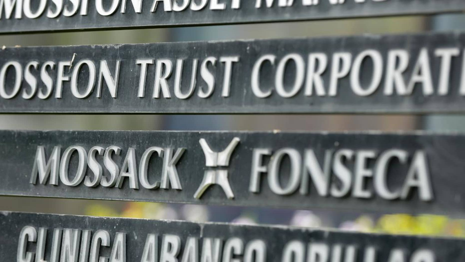"""FILE - In this April 4, 2016 file photo, a marquee of the Arango Orillac Building lists the Mossack-Fonseca law firm, in Panama City.  Prosecutors in Panama said on Saturday, Feb. 11, 2017 they've formally arrested the two partners of the Mossack-Fonseca law firm involved in last year's """"Panama Papers"""" scandal, in which thousands of pages of documents related to offshore accounts were leaked. The arrests are for money laundering related to another scandal involving bribes paid by the Brazilian company Odebrecht. (AP Photo/Arnulfo Franco, File)"""