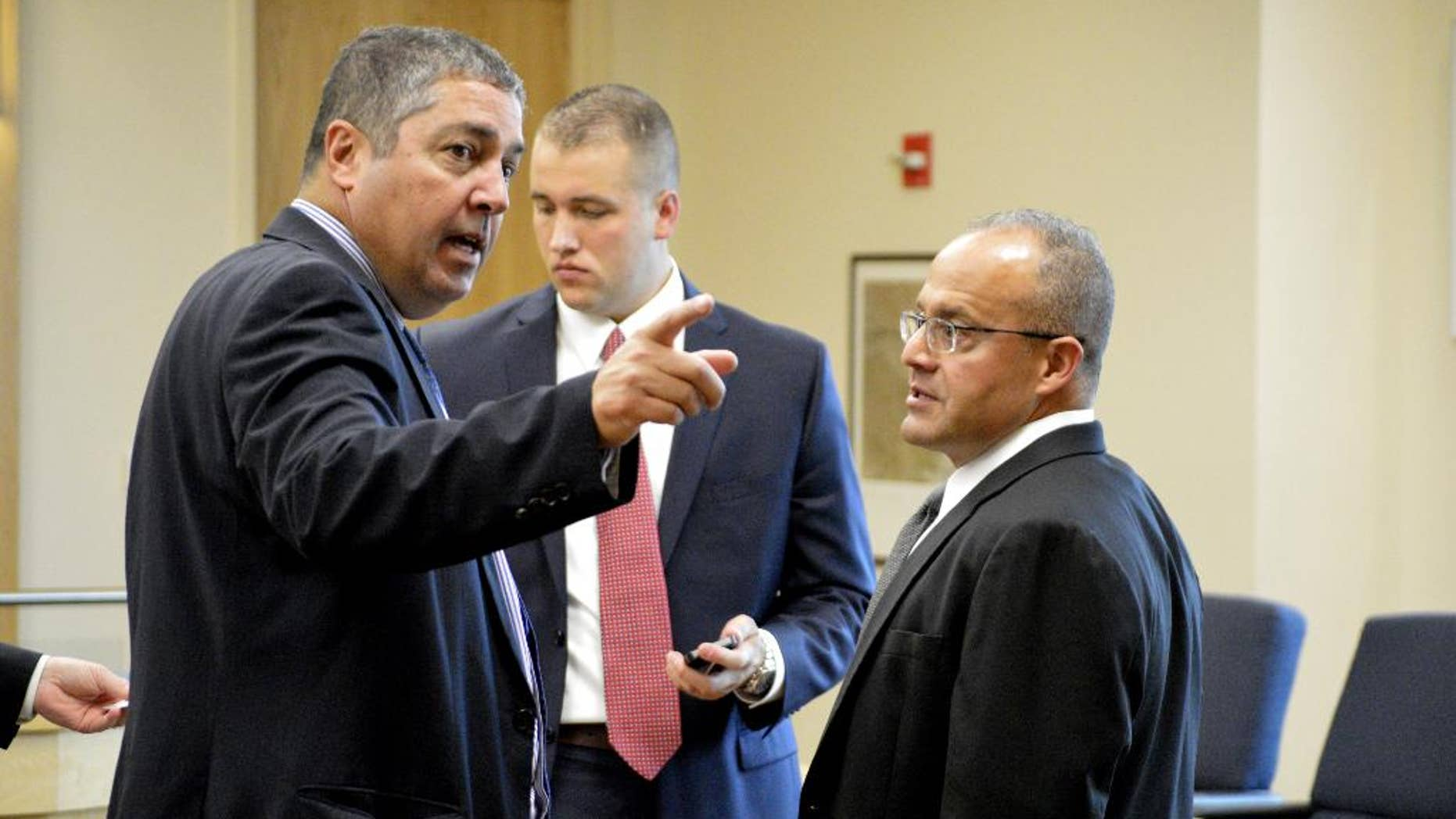 Defense attorneys Sam Bregman, left and Luis Robles, right, discuss their clients case on Friday, July 31, 2015, in Albuquerque, N.M. A former Albuquerque detective and a current officer are facing murder charges in the March 2014 fatal police shooting of a homeless man. A state judge ruled Friday that a jury can be told limited information about the homeless man's prior arrest. (AP Photo/Russell Contreras)