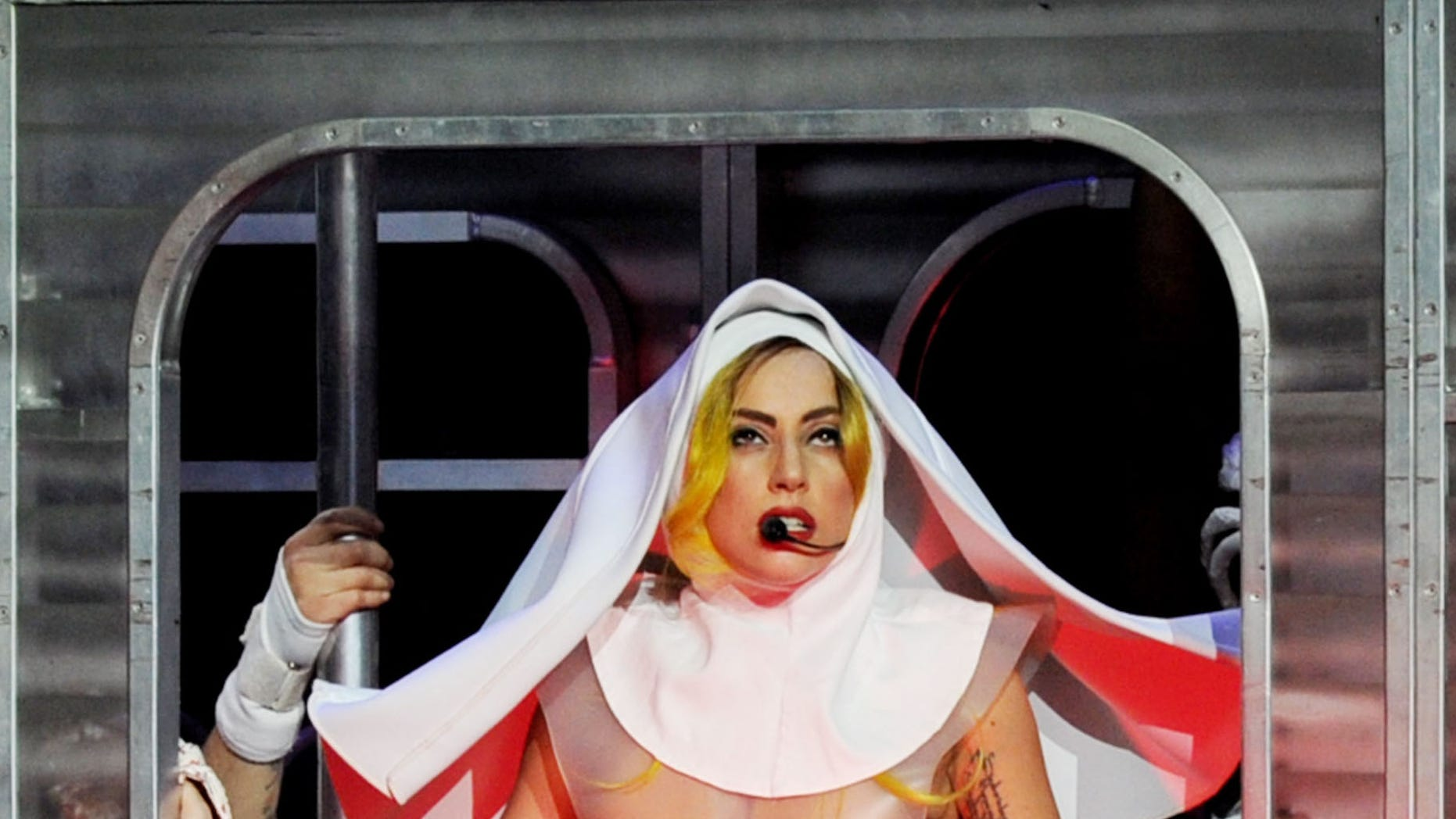 LOS ANGELES, CA - MARCH 28:  (NO ARCHIVES/EDITORIAL USE ONLY) Singer Lady Gaga performs onstage at the Staples Center on March 28, 2011 in Los Angeles, California.  (Photo by Kevin Winter/Getty Images)