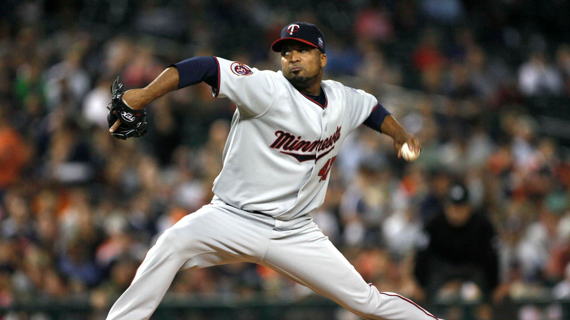 Minnesota Twins pitcher Francisco Liriano throws against the Detroit Tigers in the third inning of a baseball game in Detroit, Friday, Sept. 24, 2010. (AP Photo/Paul Sancya)