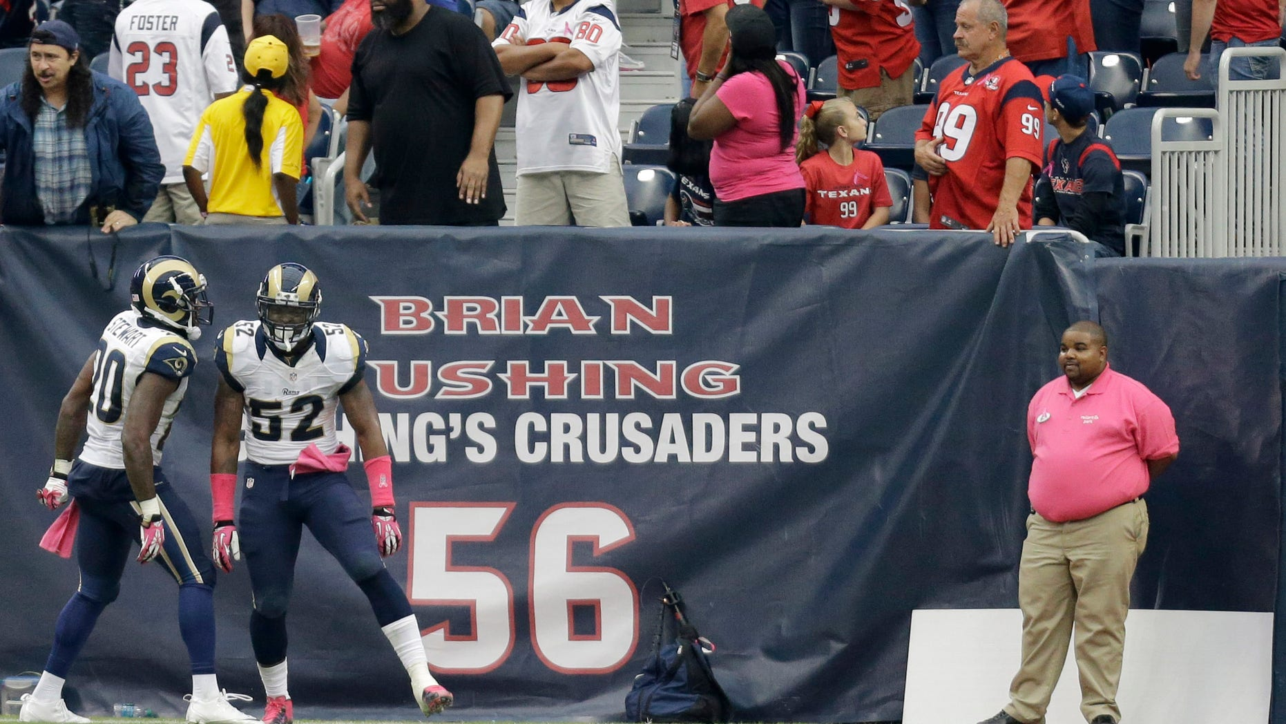 St. Louis Rams outside linebacker Alec Ogletree (52) celebrates his interception for a touchdown against the Houston Texans with Darian Stewart (20) during the third quarter of an NFL football game Sunday, Oct. 13, 2013, in Houston, Texas. (AP Photo/Eric Gay)