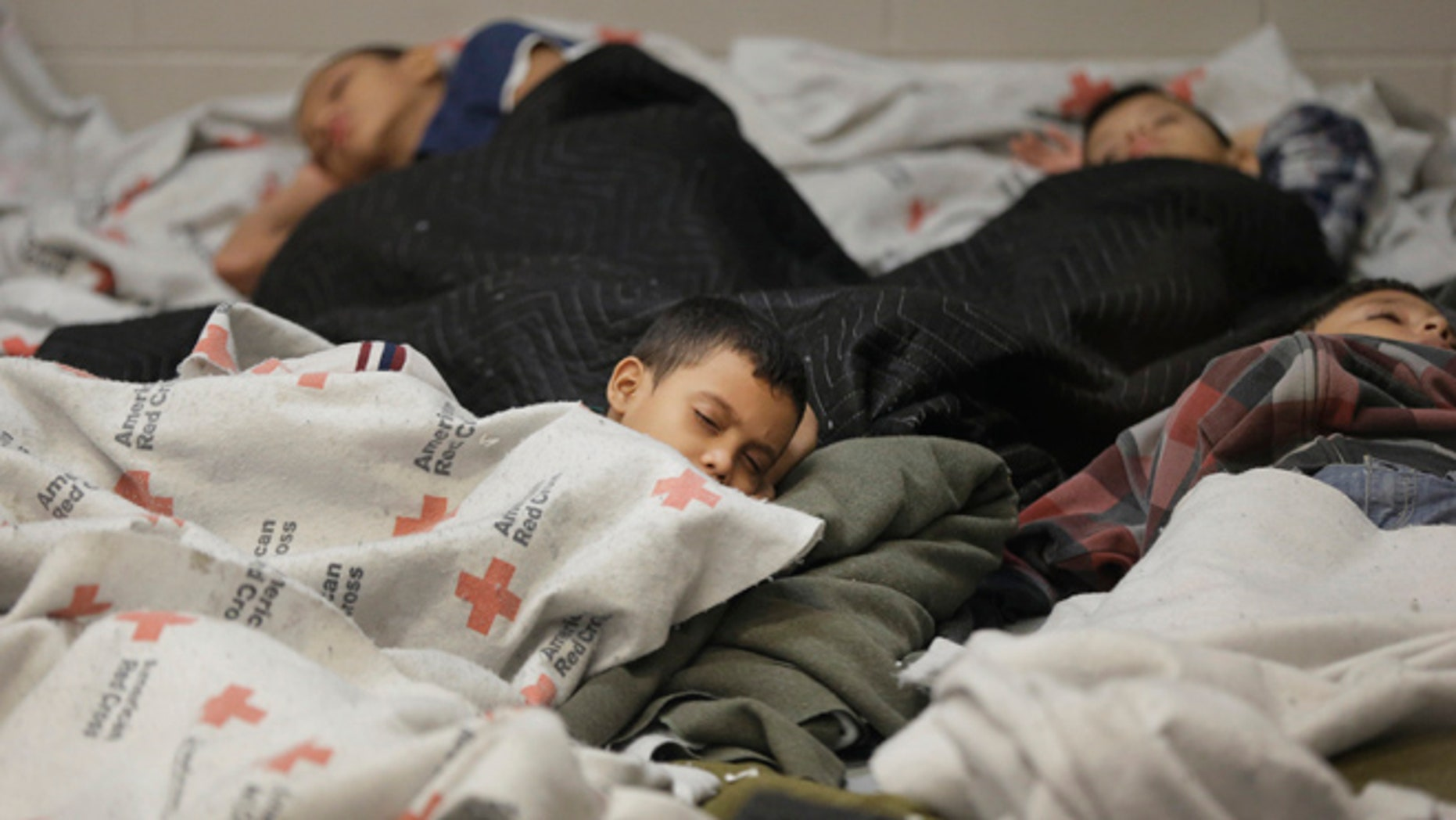 June 18, 2014: Children detainees sleep in a holding cell at a U.S. Customs and Border Protection processing facility in Brownsville, Texas. (AP)