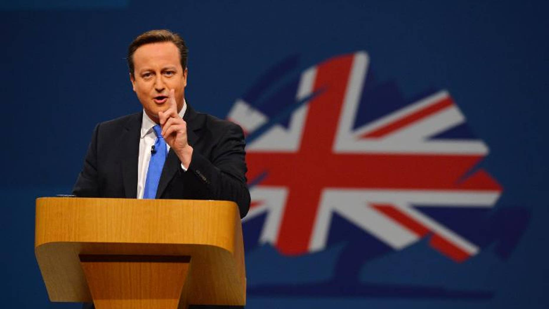 British Prime Minister David Cameron addresses delegates at the annual Conservative Party Conference in Manchester, north-west England, on October 2, 2013