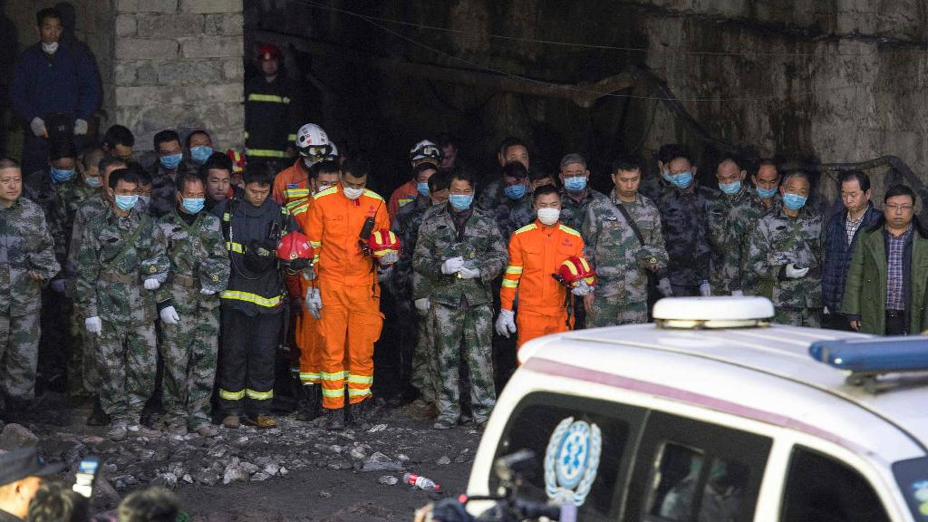 Rescuers mourn for victims at Jinshangou Coal Mine in Chongqing, southwest China, on Tuesday.