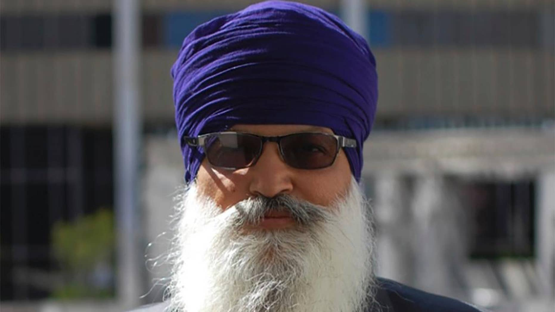 This May 12, 2015, photo provided by the Sikh Coalition shows Lakhbir Singh, one of the four truckers in the case against J.B. Hunt Transportation Services Inc., taken at the Los Angeles Equal Employment Opportunity Commission office during conciliation in Los Angeles. Four Sikh truckers who could not comply with drug testing that required them to provide clipped hair samples or remove their turban because those violate religious principles reach a settlement with a major national trucking company. (Simran Kaur/The Sikh Coalition via AP)