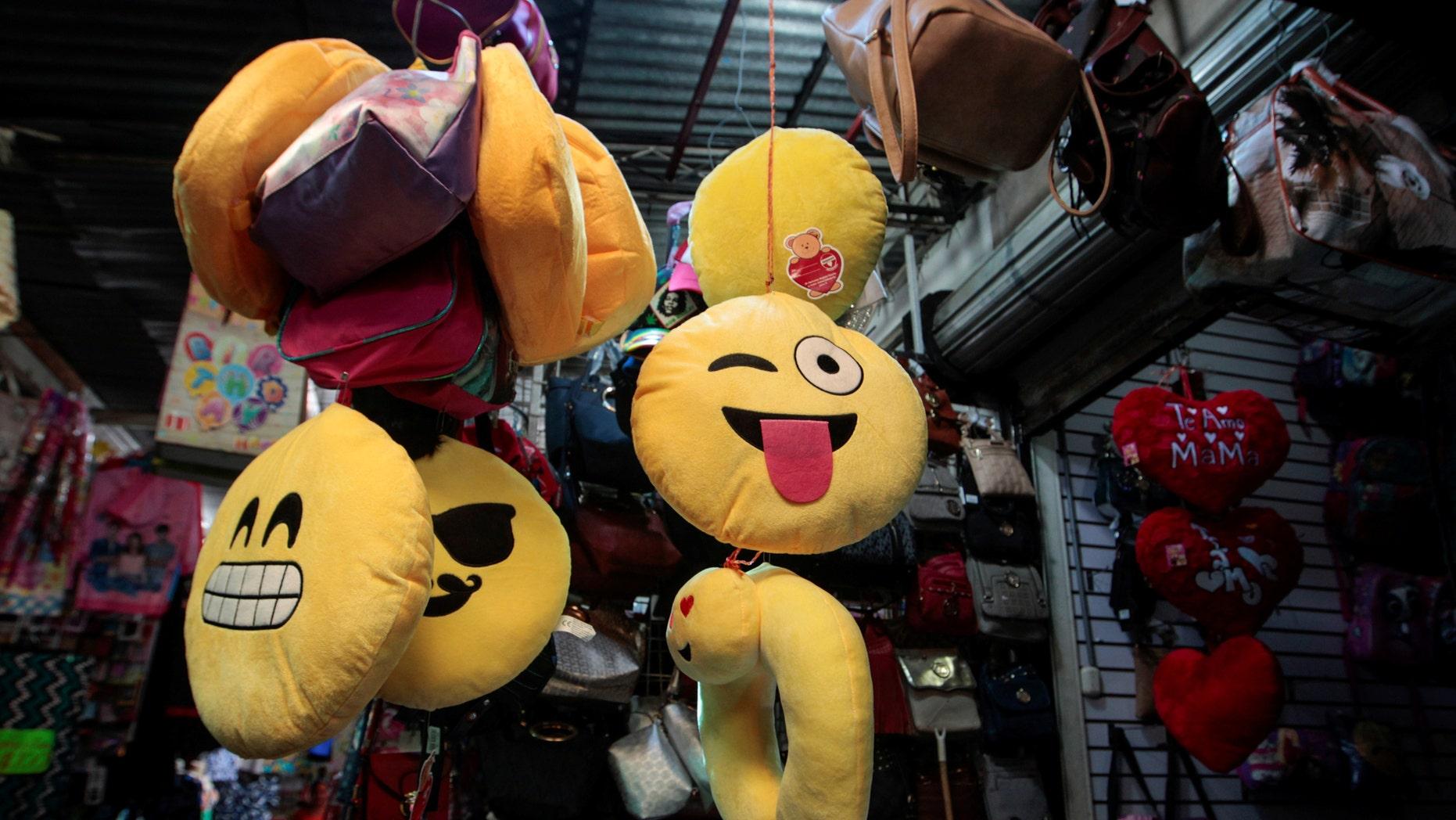 File photo: A woman sells emoji cushions at the Oriental market in Managua, Nicaragua, May 19,2017. (REUTERS/Oswaldo Rivas)