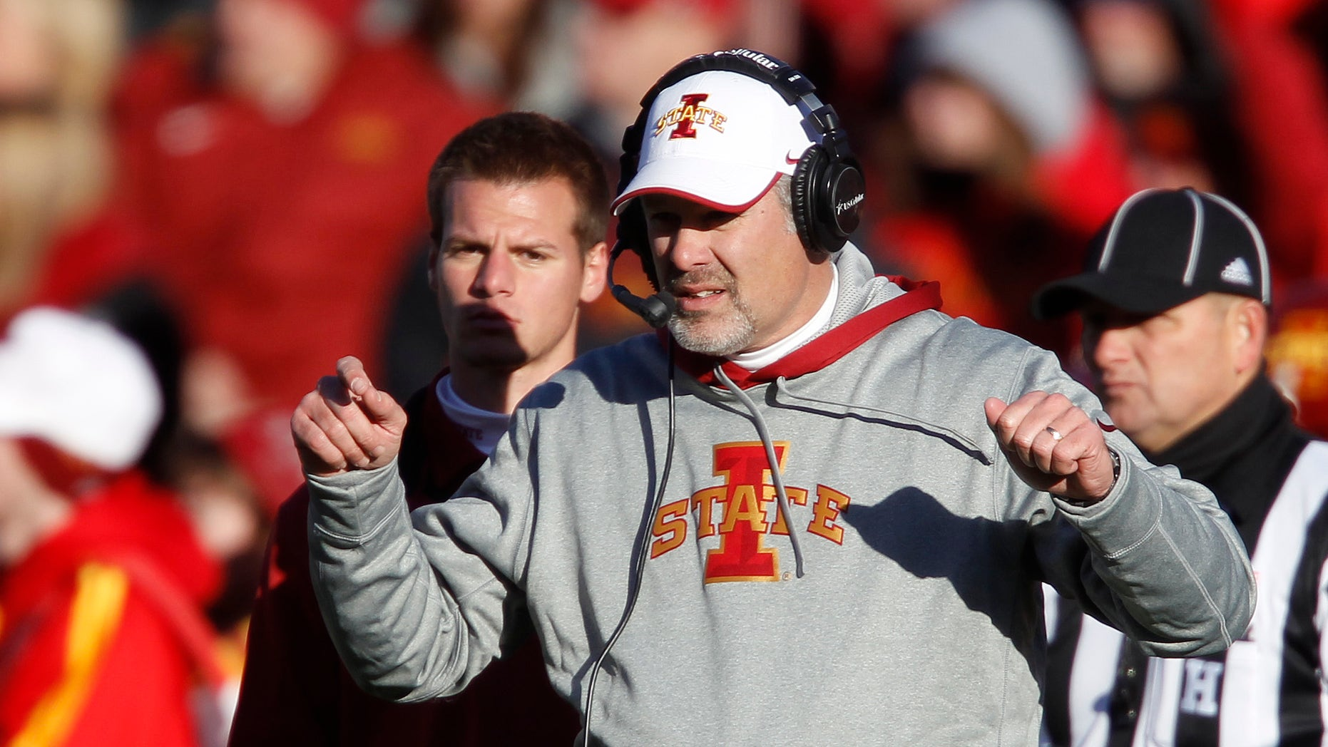 FILE - Iowa State head coach PaulRhoads directs his players during the first half of an NCAA college football game against West Virginia, in this Nov. 23, 2012 file photo taken in Ames, Iowa. Iowa State might have the best defense no one outside of Ames has heard of this season. The Cyclones held 11 of their 12 opponents below their season scoring average, and half of them at least 10 points under what they normally got.  (AP Photo/Matthew Putney, File)
