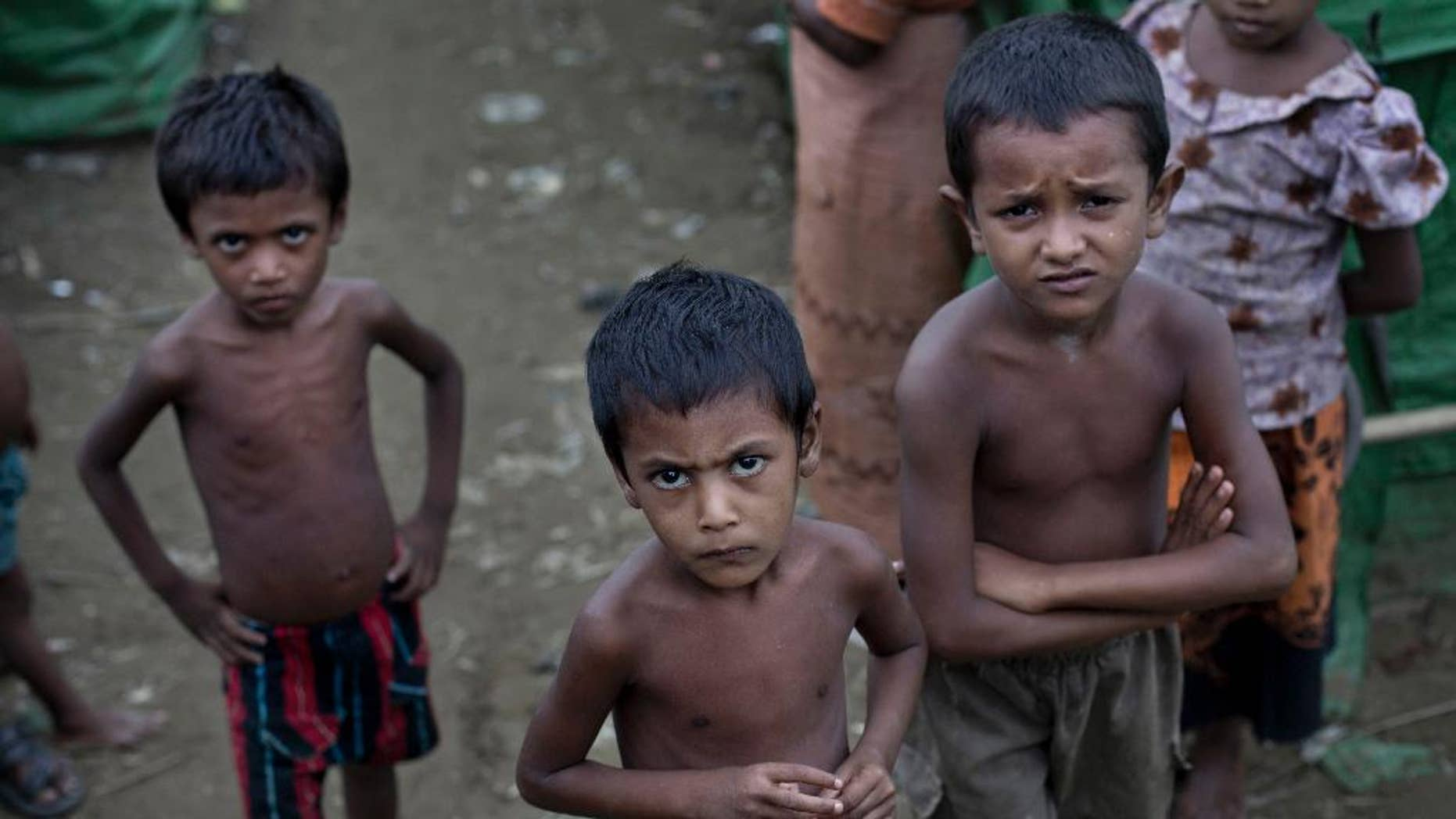 FILE - In this June 24 2014, file photo, Rohingya children gather at the Dar Paing camp for Muslim refugees, north of Sittwe, western Rakhine state, Myanmar. Activists this week have sent an open letter asking the major corporate investor conglomerate Unilever, which owns two factories near the capital Yangon, to speak out against the country's treatment of its Rohingya minority. (AP Photo/ Gemunu Amarasinghe, File)