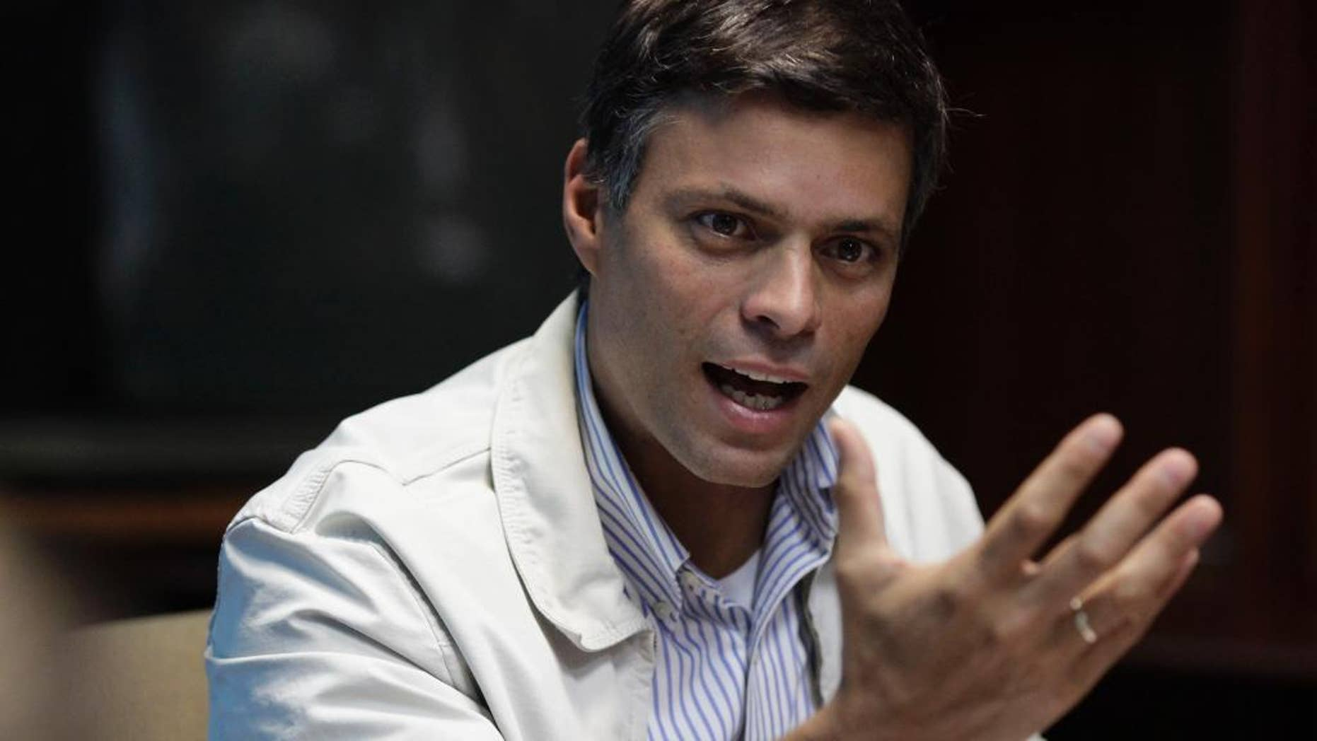 FILE - In this Feb. 26, 2013 file photo, Opposition leader Leopoldo Lopez speaks during a press conference in Caracas, Venezuela. A Venezuelan appeals court upheld on Friday, Aug. 12, 2016 the nearly 14-year prison sentence given to  Lopez for inciting violence during anti-government protests in 2014, his lawyer said. (AP Photo/Ariana Cubillos, File)