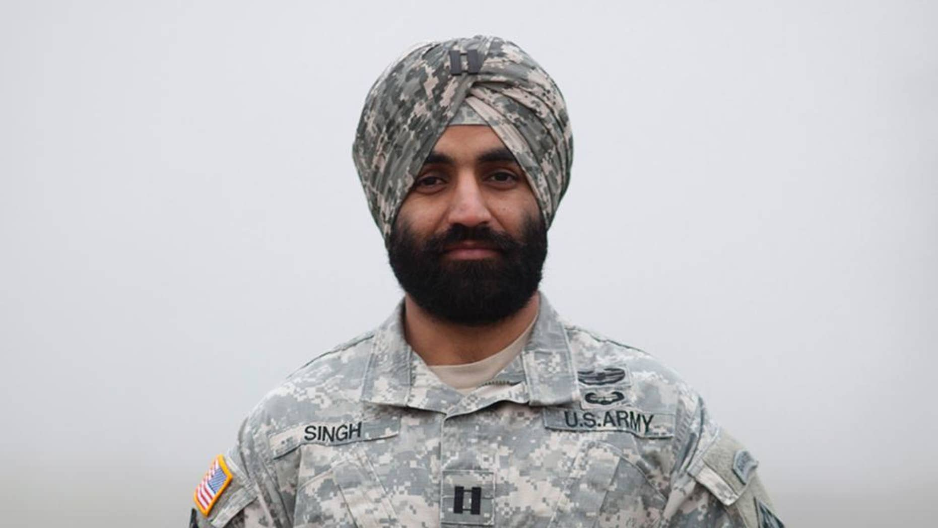 """This photo provided by the Sikh Coalition shows Army Capt. Simratpal Singh. When Singh entered the U.S. Military Academy at West Point back in 2006, he did something he thought he would never have to: shave his beard. """"One of the hardest things I had to do was look in the mirror every day and shave,"""" said Singh, whose Sikh religion requires men to grow beards as an article of faith. Now Singh and three Army enlistees have won permission to wear beards and turbans after filing federal lawsuits that seek to force the Pentagon to accommodate those who wear beards for religious reasons. Singh, won an administrative exception under an Army policy that allows exemptions to the no-beard policy on a case-by-case basis. (Jovelle Tamayo/Sikh Coalition via AP)"""