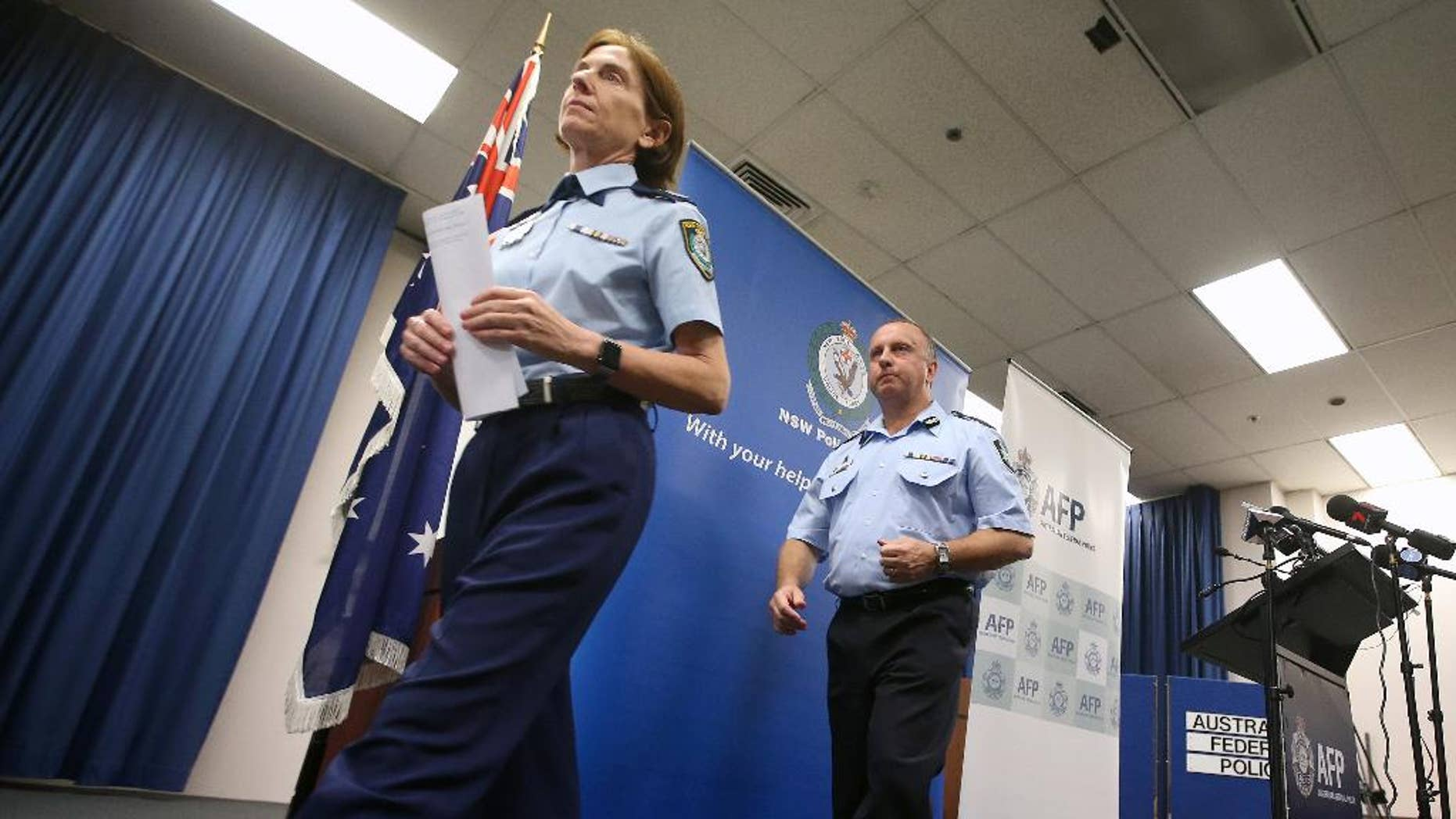 """FILE - In this May 17, 2016 file photo, New South Wales Deputy Police Commissioner Catherine Burn, left, and Australian Federal Police Acting Deputy Commissioner Neil Gaughan leave a news conference in Sydney. A man charged with committing a terrorist act and attempted murder after allegedly stabbing a man in Sydney was inspired by the Islamic State group, police said Sunday, Sept. 11. The suspect, Ihsas Khan, 22, and Wayne Greenhalgh, 59, who was stabbed several times by Khan, did not know each other, and Burn described the attack as planned and deliberate. """"This was clearly a very volatile, a very violent situation that police and the members of the community were confronted with,"""" Burn told reporters. (AP Photo/Rick Rycroft, File)"""