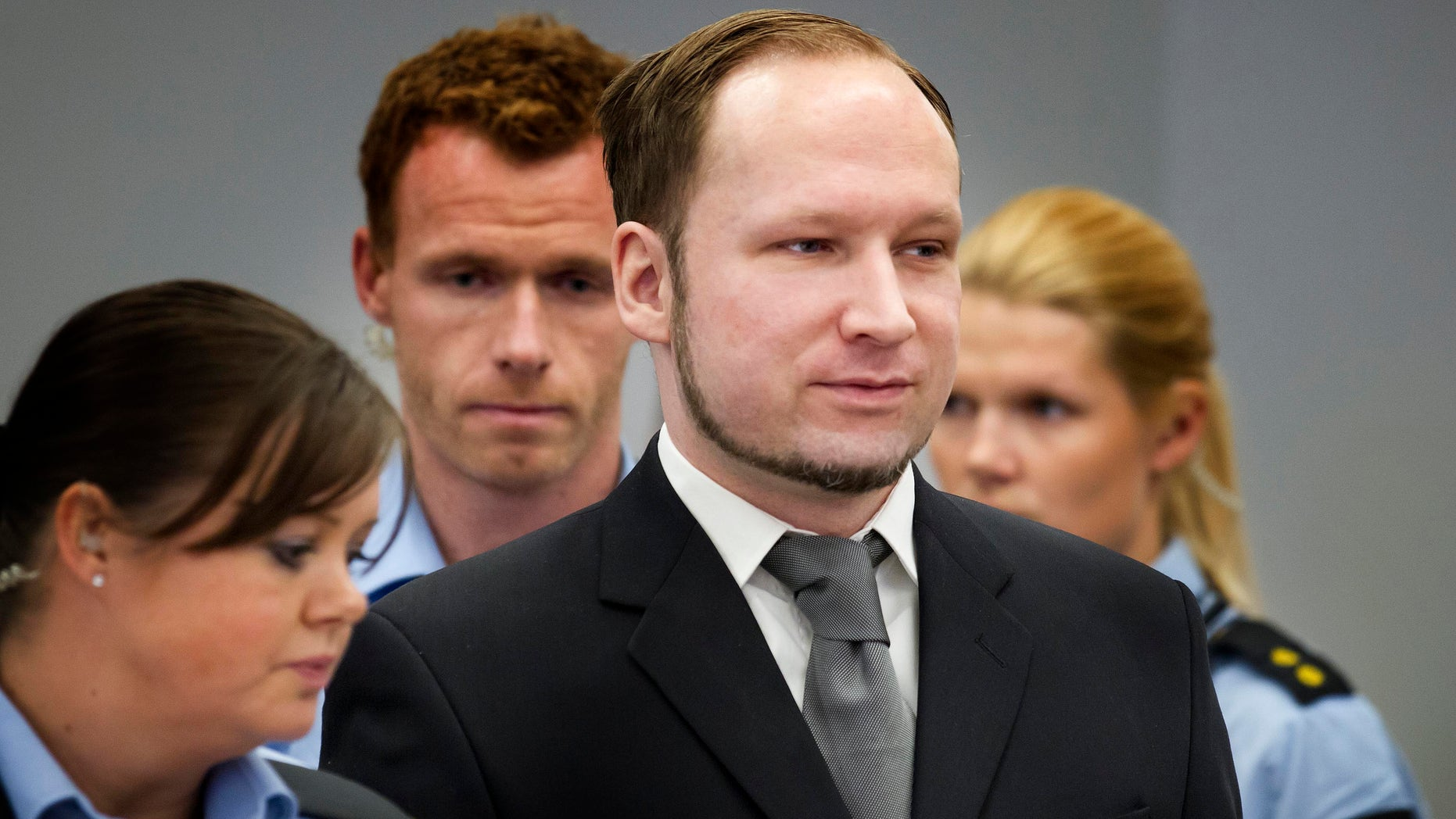 May 3: Anders Behnring Breivik, center, stands in the Oslo Courthouse in Norway.