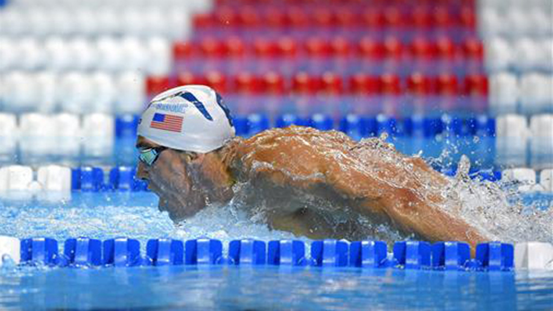 Michael Phelps swims in a men's 200-meter butterfly semifinal at the U.S. Olympic swimming trials, Tuesday, June 28, 2016, in Omaha, Neb.