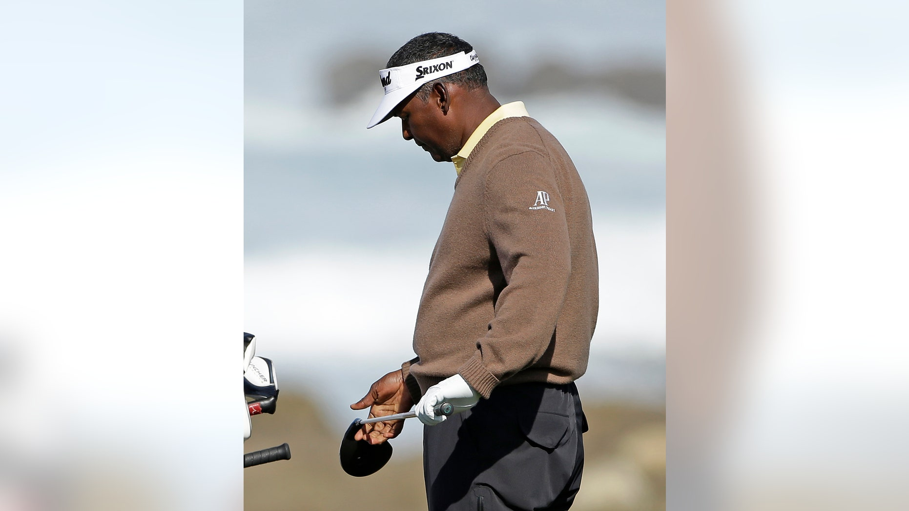 Vijay Singh, of Fiji, looks over his driver before hitting from the 13th tee of the Monterey Penisnula Country Club Shore Course during the second round of the AT&T Pebble Beach Pro-Am golf tournament on Friday, Feb. 8, 2013, in Pebble Beach, Calif. (AP Photo/Eric Risberg)