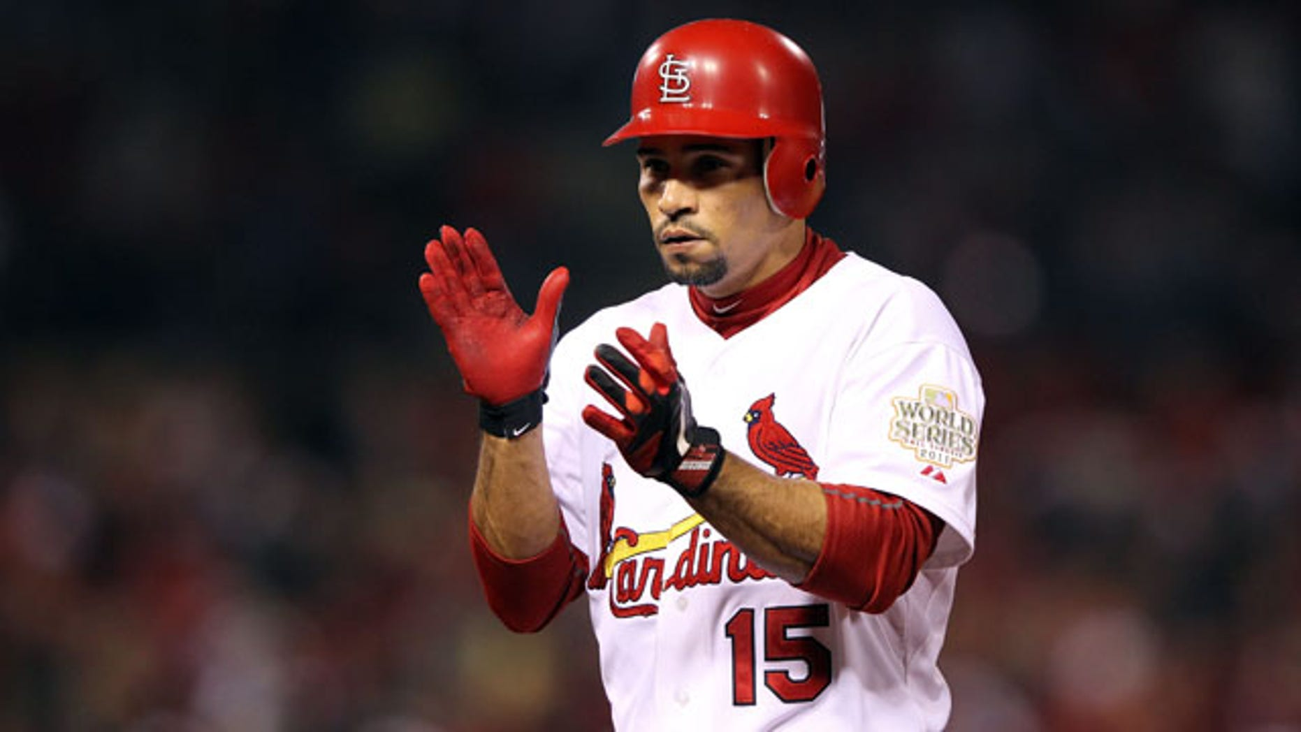 ST LOUIS, MO - OCTOBER 28:  Rafael Furcal #15 of the St. Louis Cardinals celebrates after hitting a single in the second inning during Game Seven of the MLB World Series against the Texas Rangers at Busch Stadium on October 28, 2011 in St Louis, Missouri.  (Photo by Jamie Squire/Getty Images)