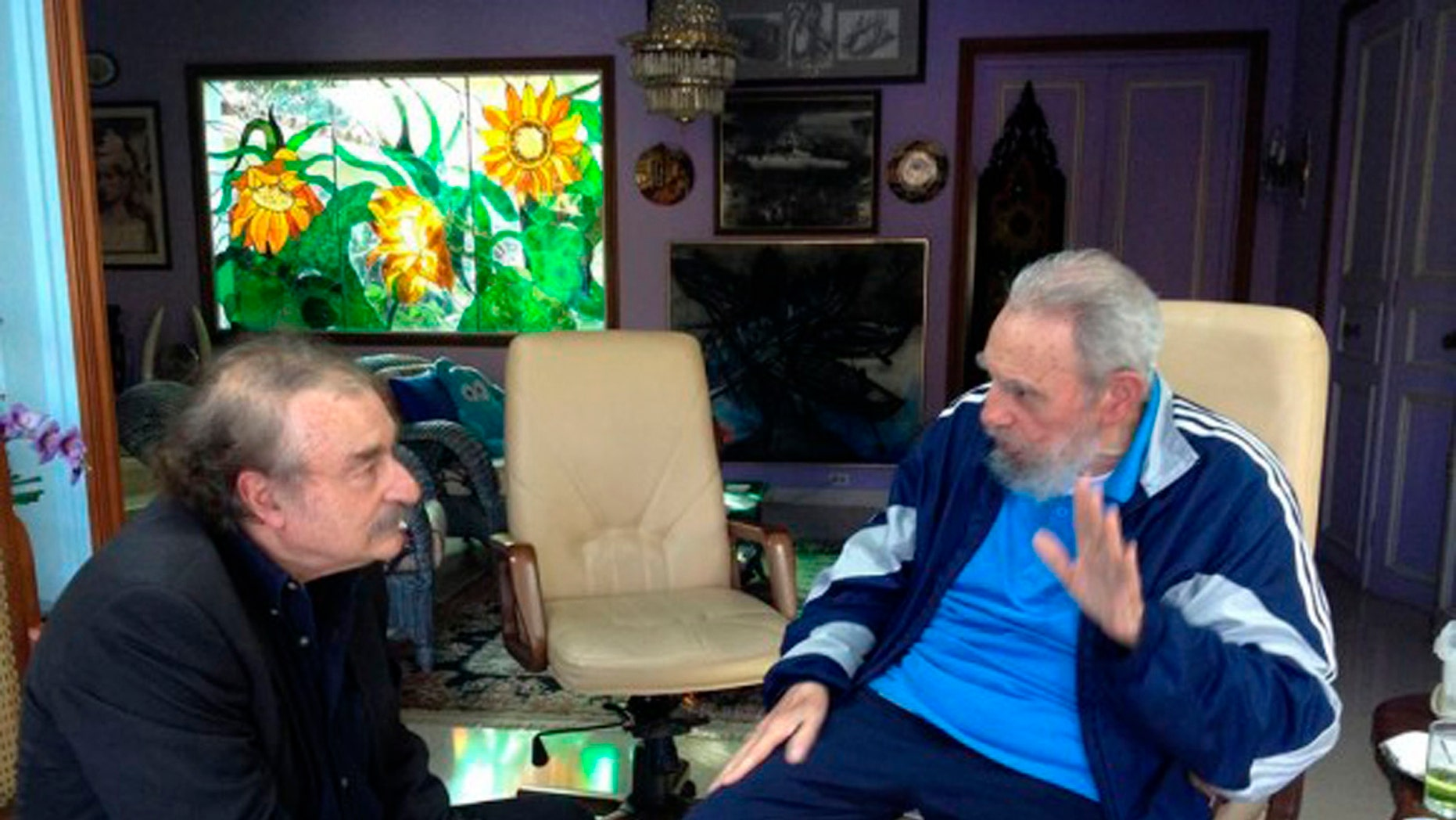 In this Friday, Dec. 13, 2013 photo released by the state media Cubadebate website, Cuban leader Fidel Castro, right, talks with Spanish journalist, writer and former editor-in-chief of Le Monde diplomatique, Ignacio Ramonet in Havana, Cuba. (AP Photo/Granma, Estudios Revolucion)