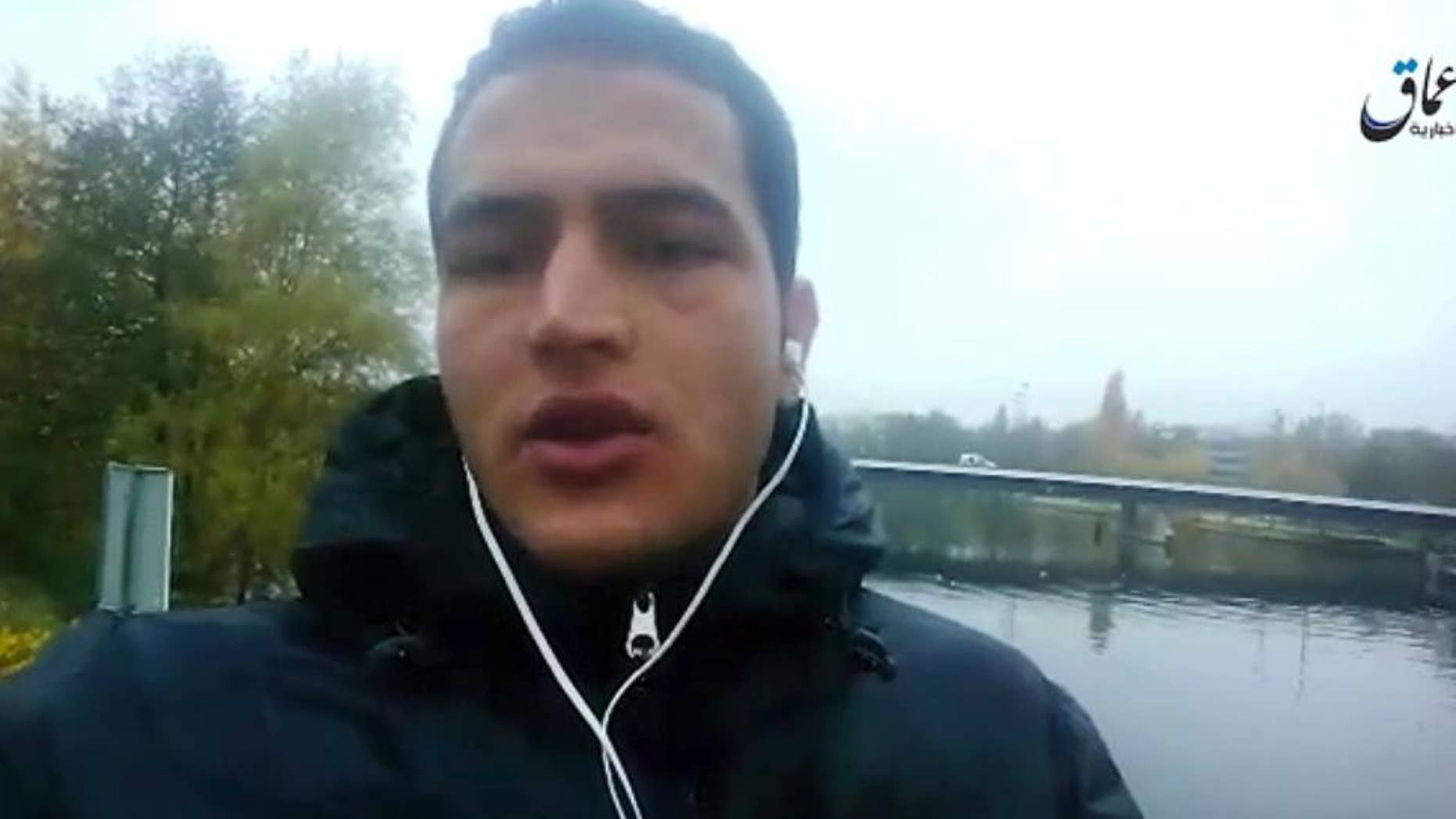 "Dec. 23, 2016: This image made from video released by ISIS, shows Anis Amri, a Tunisian suspect in the Berlin truck attack, pledging allegiance to its leader Abu Bakr al-Baghdadi and vowing to fight against what he calls ""the Crusader pigs."""