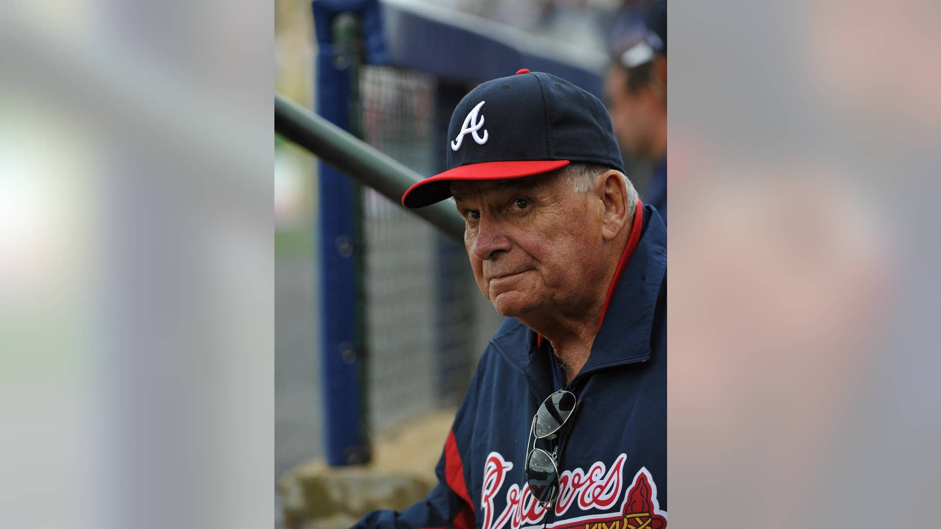 Former Atlanta Braves manager Bobby Cox watches from the dugout as he manages the minor league Future Stars against the Atlanta Braves in an exhibition baseball game Saturday, March 29, 2014, in Rome, Ga. (Associated Press)