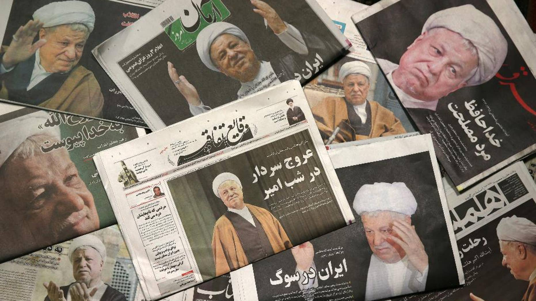 Front pages of the Monday, Jan. 9, 2017, edition of Iranian newspapers, published with pictures of former President Akbar Hashemi Rafsanjani, who died on Sunday after suffering a heart attack. Newspapers in Iran published front-page photographs of Rafsanjani, while state television aired archival clips of his comments and speeches. Mourners from all walks of life in Iran - from the country's president to passers-by on the street - paid their respects to him. The country is observing three days of mourning. (AP Photo/Vahid Salemi)