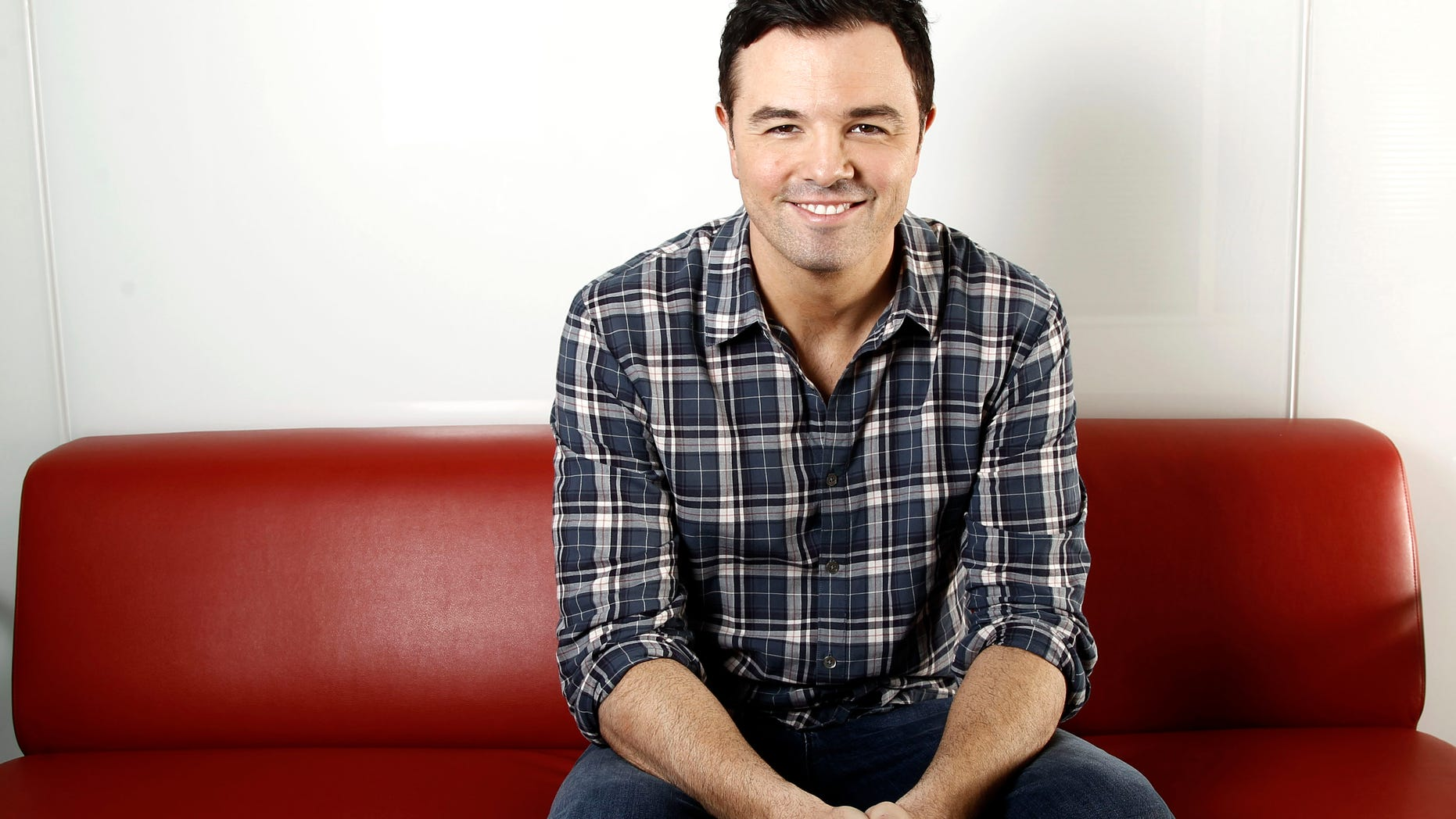 """FILE - This Oct. 1, 2011 file photo shows Seth MacFarlane in Los Angeles. NBC announced Wednesday, Aug. 29, 2012, that Seth MacFarlane will host""""Saturday Night Live"""" for its 38th season premiere on Sept. 15. Musical guest will be Frank Ocean. The multitalented MacFarlane created the Fox series """"Family Guy"""" and serves as writer, producer and voice artist on the show. He recently directed his first feature film, """"Ted,"""" and furnished the voice for its teddy-bear title character. (AP Photo/Matt Sayles, file)"""