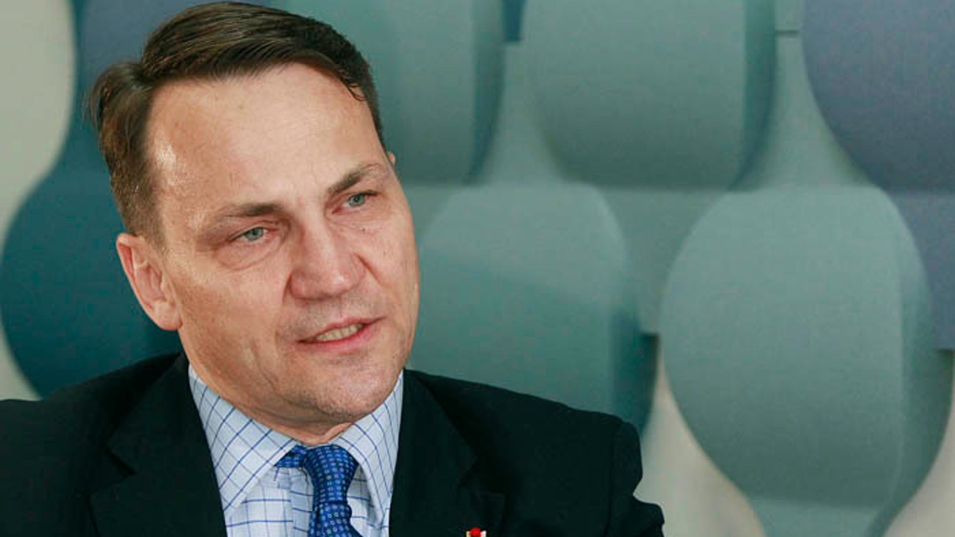 FILE In this May 16, 2016,file photo Radek Sikorski, a former Polish foreign ministers, speaks to The Associated Press in Warsaw, Poland, on Monday May 16, 2016. Sikorski was among several former Polish leaders whose conversations were illegally recorded in Warsaw restaurant in 2003 and 2004, prompting a scandal that cost him and others their jobs. In Warsaw, Poland, Thursday, Dec. 29, 2016  a Polish court sentenced a Polish businessman to 2 1/2 years of prison for planning the wiretapping. Two waiters also got lesser sentences in the case and one waiter was fined. (AP Photo/Czarek Sokolowski)