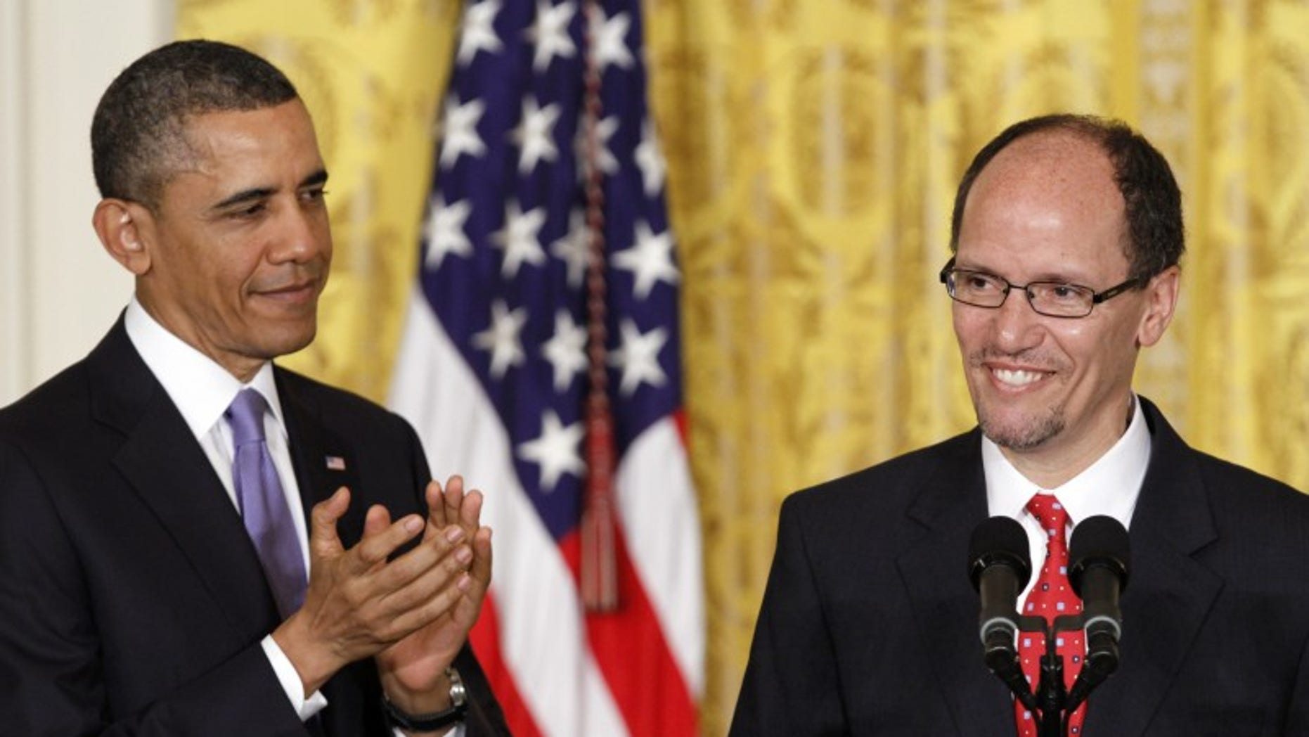 President Barack Obama applauds in the East Room of the White House in Washington, Monday March 18, 2013, where he announced he would nominate Thomas E. Perez, right, for Labor Secretary.  (AP Photo/Jacquelyn Martin)