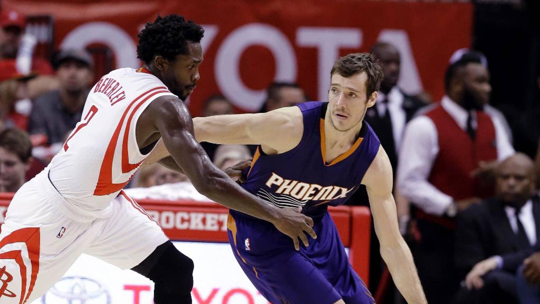 Phoenix Suns' Goran Dragic (1) is pressured by Houston Rockets' Patrick Beverley (2) in the second half of an NBA basketball game Saturday, Dec. 6, 2014, in Houston. The Rockets won 100-95. (AP Photo/Pat Sullivan)