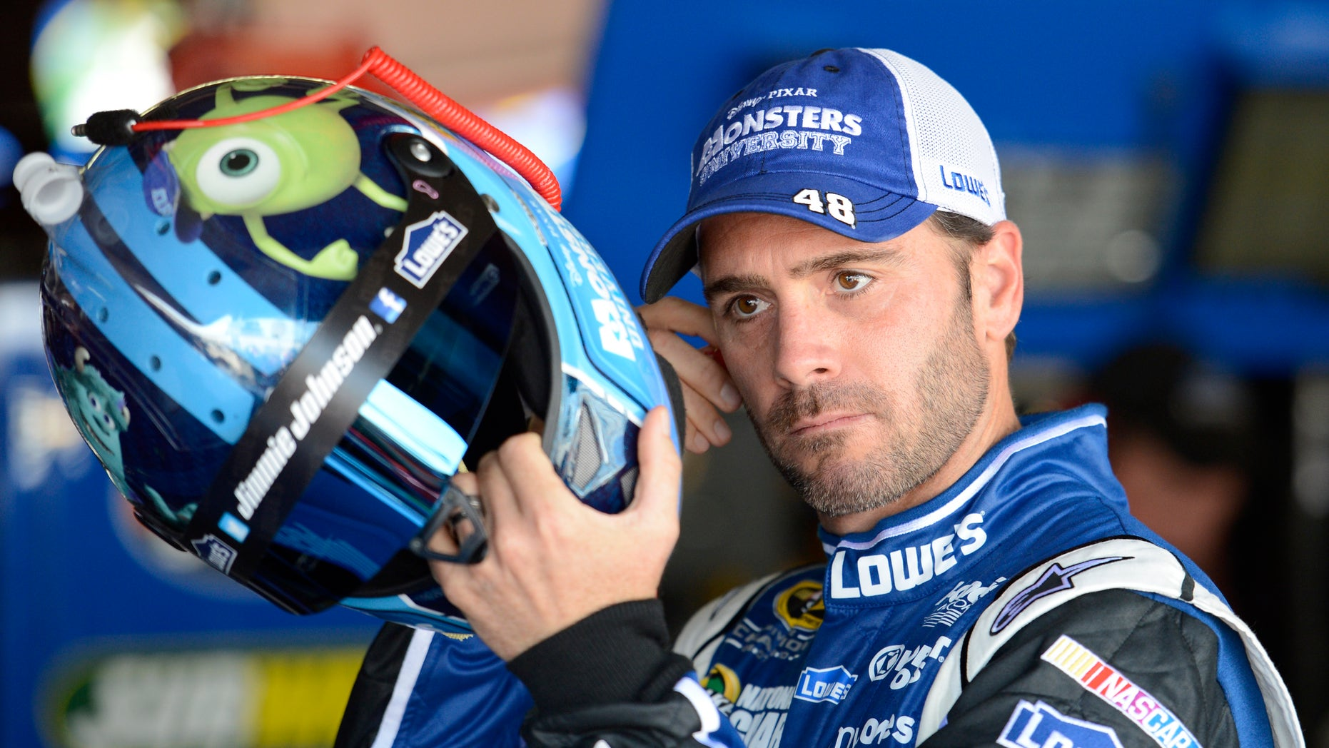 Driver Jimmie Johnson gets ready for practice for the NASCAR Sprint Cup series auto race, Friday, May 31, 2013, at Dover International Speedway in Dover, Del. (AP Photo/Nick Wass)