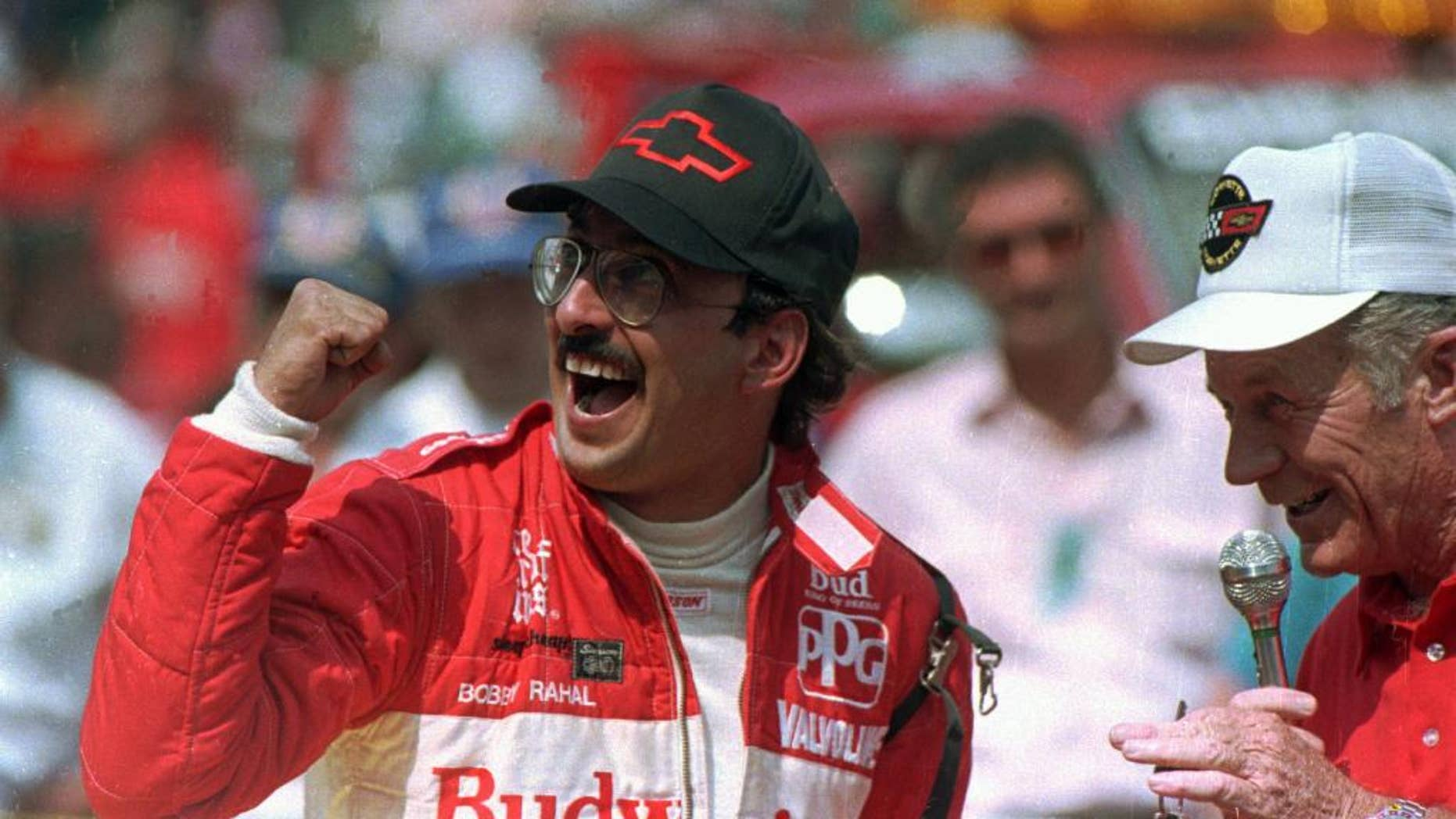 FILE - In this May 31, 1986 file photo, Bobby Rahal reacts after accepting the keys to the Chevrolet Corvette pace car after winning the 70th running of the Indianapolis 500 auto race in Indianapolis, Ind. (AP Photo/File)