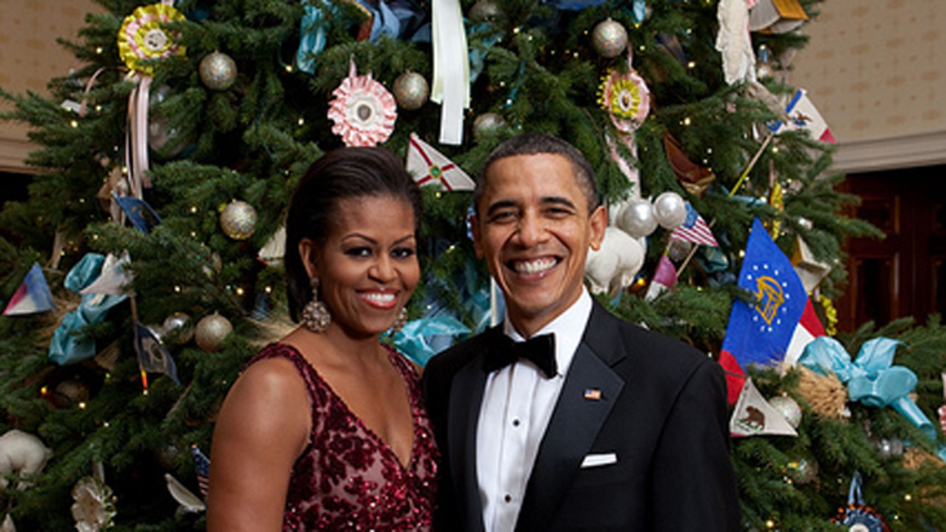 President Barack Obama and First Lady Michelle Obama pose in front of the Official White House Christmas Tree in the Blue Room of the White House, Dec. 5, 2010. (Official White House Photo by Chuck Kennedy)This official White House photograph is being made available only for publication by news organizations and/or for personal use printing by the subject(s) of the photograph. The photograph may not be manipulated in any way and may not be used in commercial or political materials, advertisements, emails, products, promotions that in any way suggests approval or endorsement of the President, the First Family, or the White House.