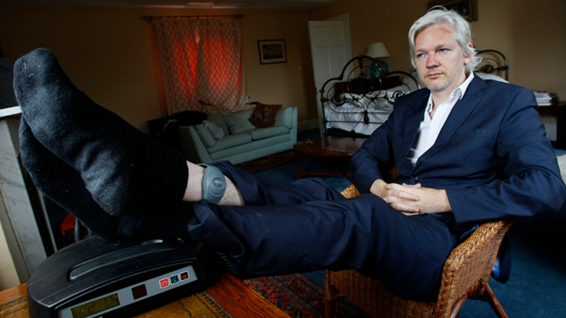 June 15, 2011: WikiLeaks founder Julian Assange is seen with his ankle security tag at the house where he is required to stay in, near Bungay, England.