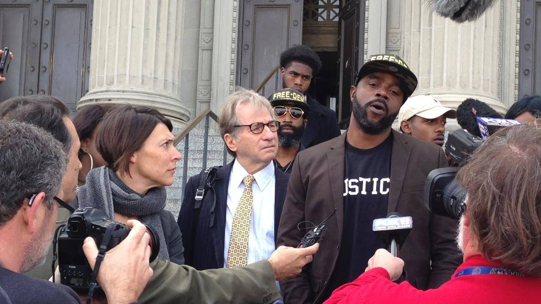 Robert Jones, right, speaks with reporters, with defense attorneys Emily Maw, left, and Barry Scheck, at the New Orleans courthouse, Thursday, Jan. 26, 2017. Prosecutors formally dropped charges Thursday against Jones who spent more than 20 years behind bars for a 1992 crime spree that included the slaying of a British tourist. (AP Photo/Kevin McGill)