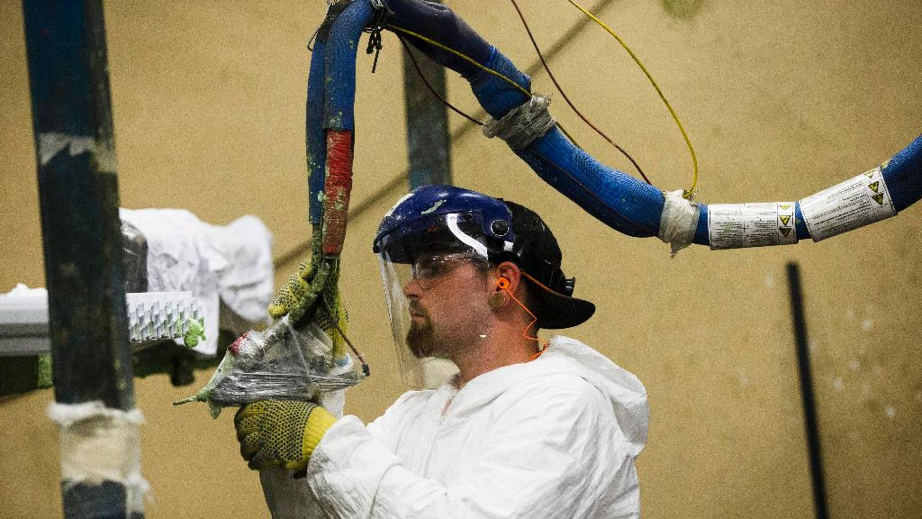 FILE - In this Aug. 7, 2014 photo, a worker assembles construction supplies at Northeast Building Products in Philadelphia. The Commerce Department releases factory orders for July on Wednesday, Sept. 2, 2015. (AP Photo/Matt Rourke, File)