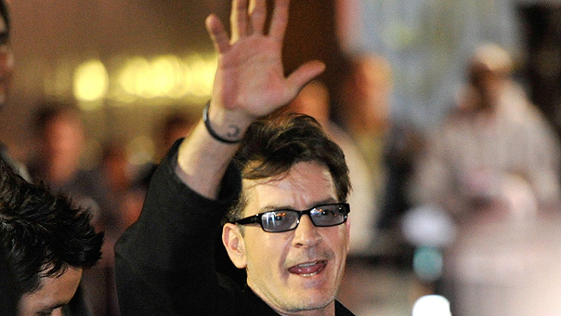 April 3: Charlie Sheen waves to fans as he leaves the Chicago Theatre in Chicago.