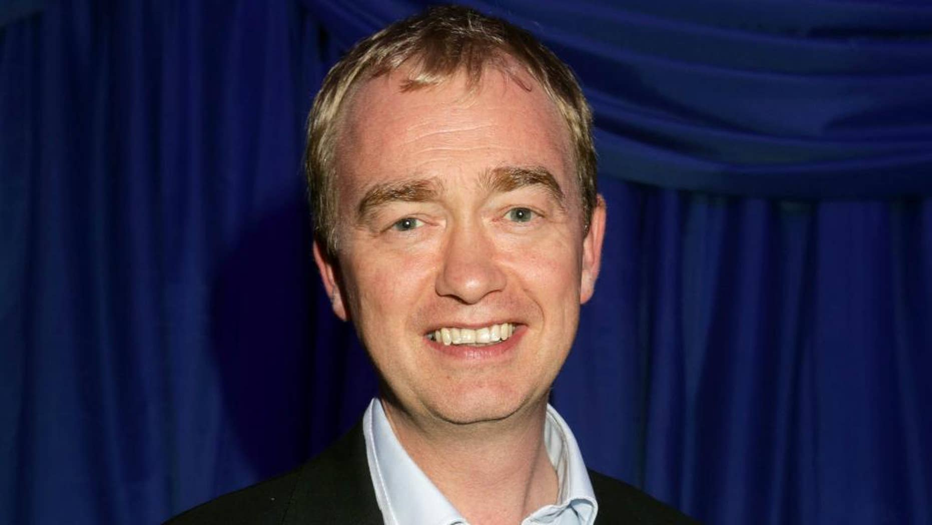 """FILE - In this Thursday, Nov. 8, 2016 file photo, Liberal Democrat leader Tim Farron attends the US Embassy's election night party in central London. A  British opposition party says it will vote against starting exit talks with the European Union unless the government promises a new referendum before leaving the bloc. Liberal Democrat leader Tim Farron said Friday, Nov. 11, 2016 that his party would vote against starting exit negotiations unless voters got to """"have their say in a referendum on the terms of the deal"""" between Britain and the EU.  (Yui Mok/PA via AP, File)"""