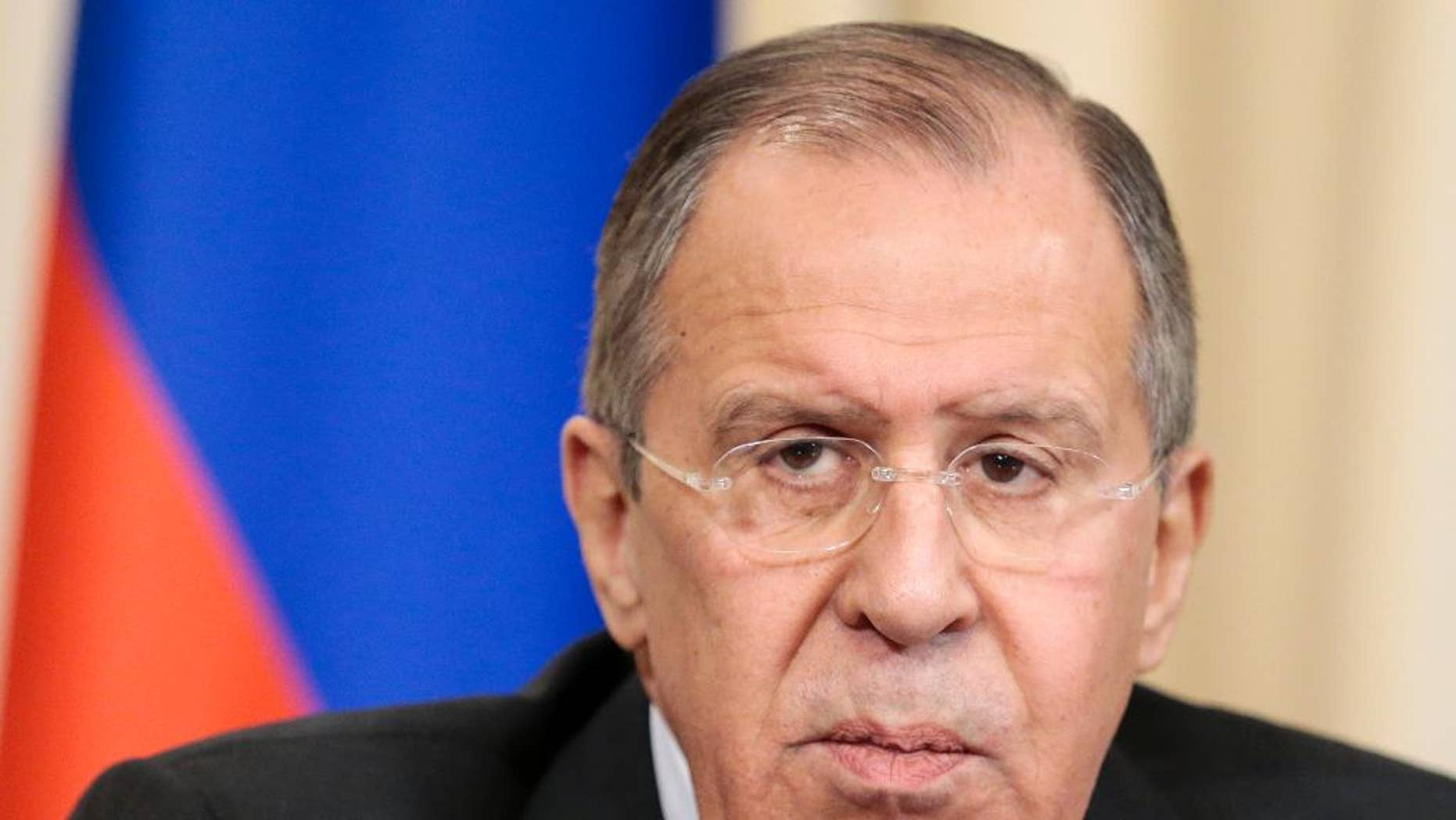 Russian Foreign Minister Sergey Lavrov listens for a question during a shared news conference with High Representative of the European Union for Foreign Affairs Federica Mogherini following their talks n Moscow, Russia, Monday, April 24, 2017. Lavrov has vowed to use Moscow's influence to get Ukraine's separatist rebels to comply with a cease-fire deal. (AP Photo/Ivan Sekretarev)