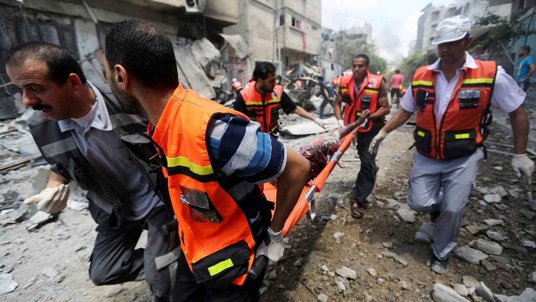 July 20, 2014: Palestinian medics carry a man injured in Gaza City's Shijaiyah neighborhood in the northern Gaza Strip of Israel.