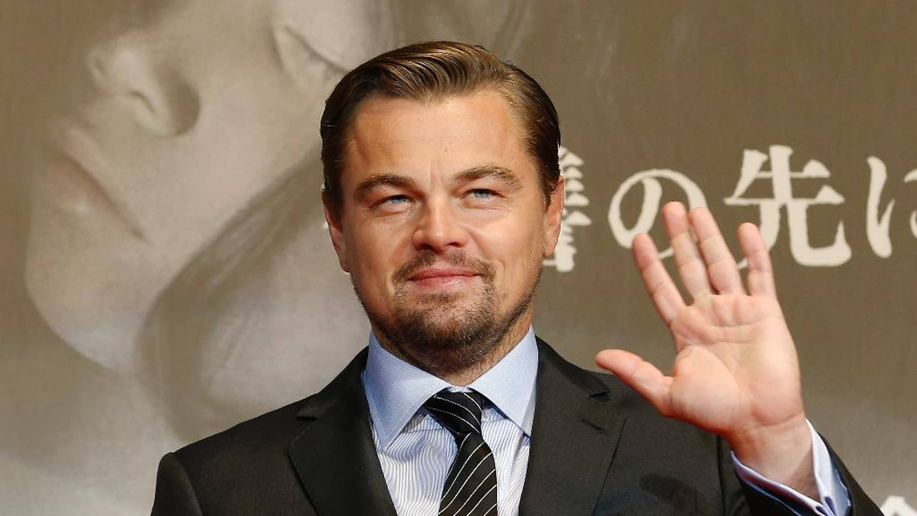 """FILE - In this March 23, 2016 file photo, American actor Leonardo DiCaprio waves for fans during the Japan premiere of his new movie """"The Revenant"""" in Tokyo, Japan. Indonesia's environment and forestry minister says Oscar-winning actor DiCaprio lacked complete information when he criticized the destruction of rainforests during a visit to a protected national park in March. His comments prompted immigration officials to warn that DiCaprio could be barred from reentering Indonesia, but the minister, Siti Nurbaya, said she appreciates his good intentions and hopes to cooperate with him in future. (AP Photo/Shizuo Kambayashi, File)"""