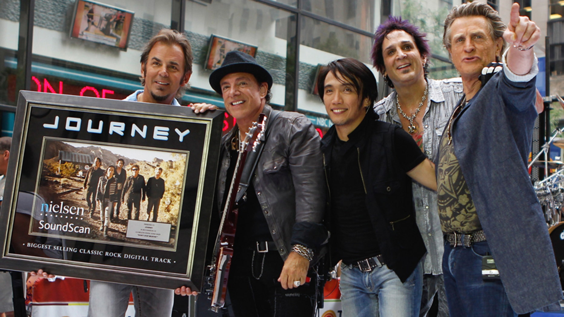Journey band members (L-R) Jonathan Cain, Neal Schon, Arnel Pineda, Deen Castronovo, and Ross Valory pose together after performing on NBC's Today Show in New York July 29, 2011.  REUTERS